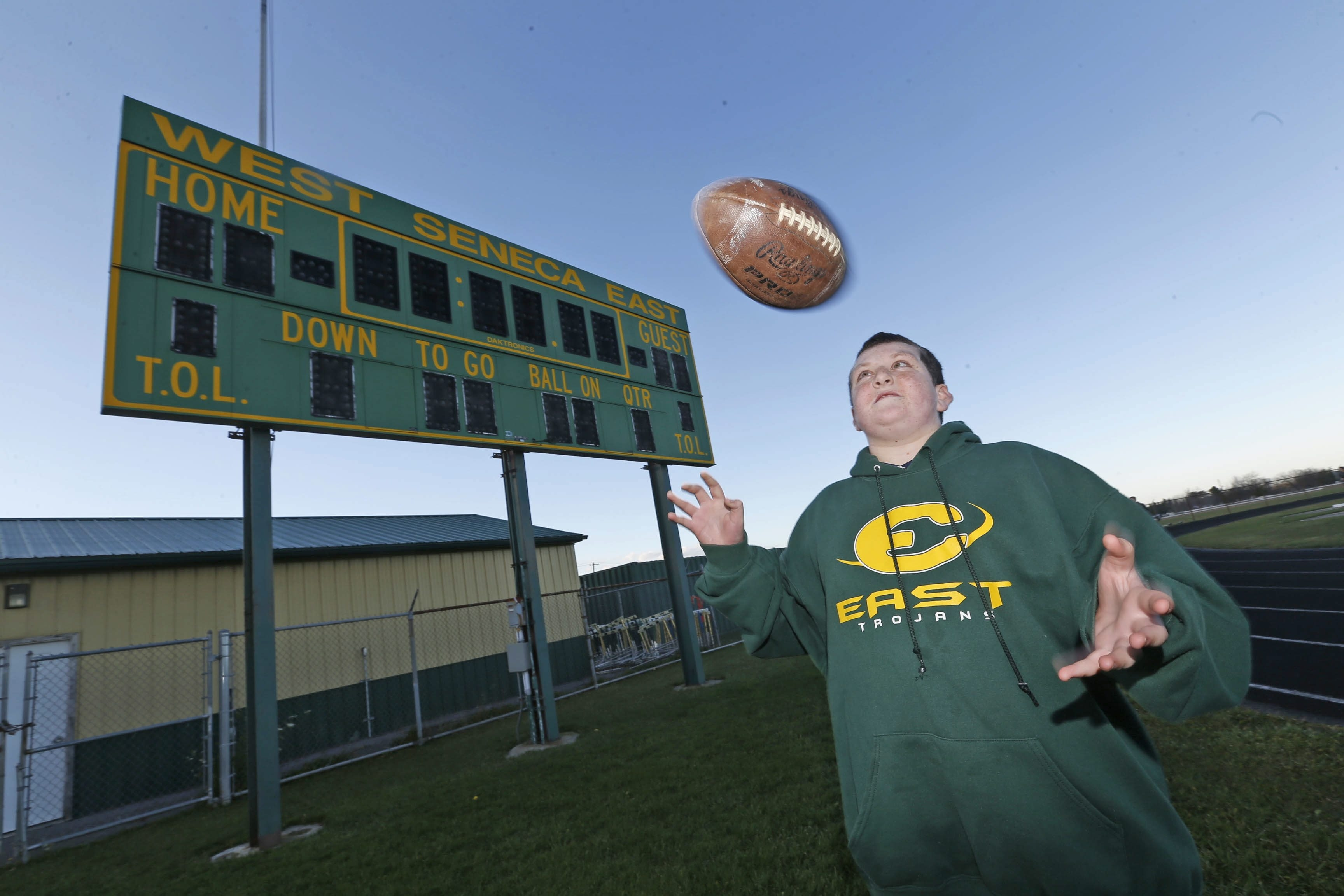 Nick Ramunno, 13, near the scoreboard at West Seneca East High School's athletic field that he got to light up with his touchdown.