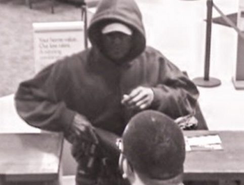 Bank surveillance photo of robbery suspect.
