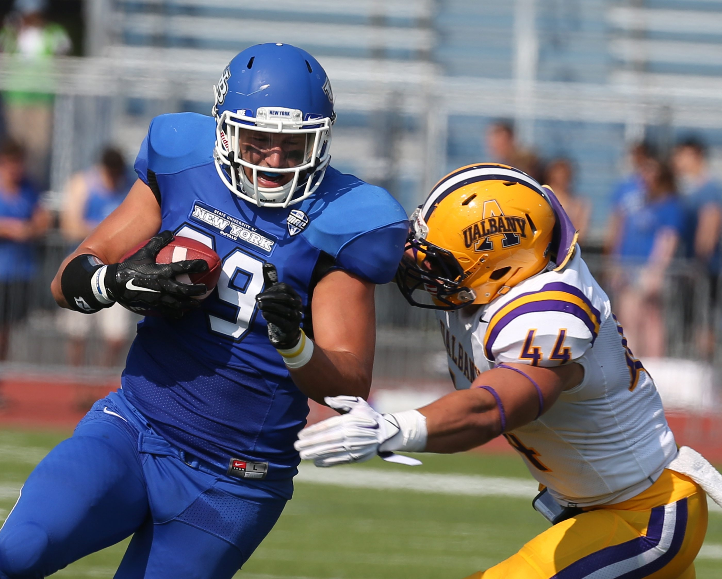Buffalo Bulls tight end Matt Weiser (89) beats Albany Great Danes linebacker Colin Cooper (44) for a first down in the first quarter at Universitiy at Buffalo Stadium in Amherst,NY on Saturday, Sept. 5, 2015.  (James P. McCoy/ Buffalo News)