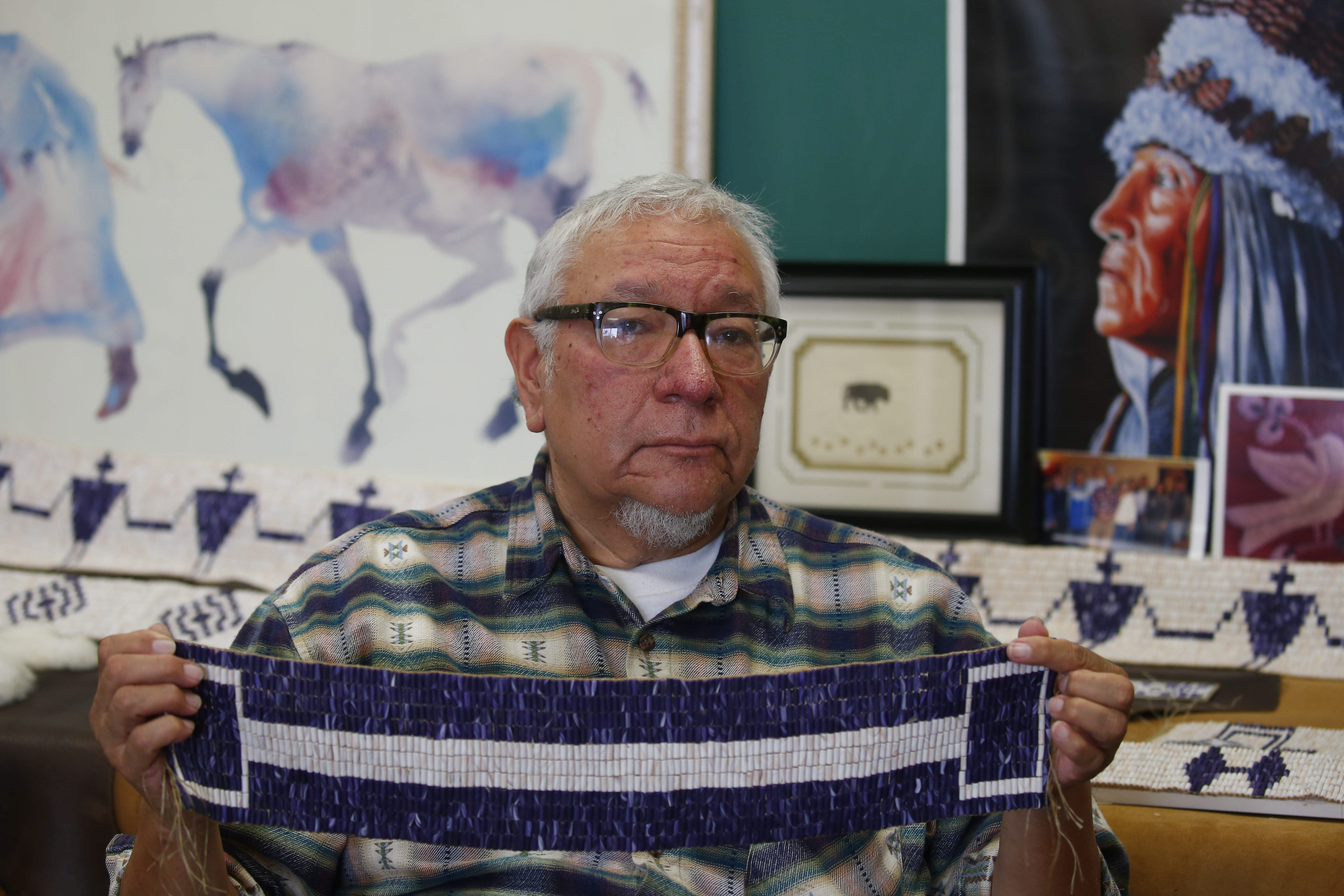 Allan Jamieson holds a replica wampum belt at the Niagara Arts and Cultural Center in Niagara Falls. Only 40 to 50 of the original Six Nations belts survive, and they have gradually been returned to their original owners.
