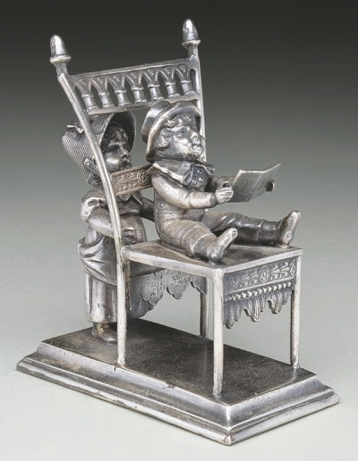 This figural napkin ring sold at a Maine auction for $889. The two figures, attractive chair, maker's mark and condition of the silver plating all added up to a high value.