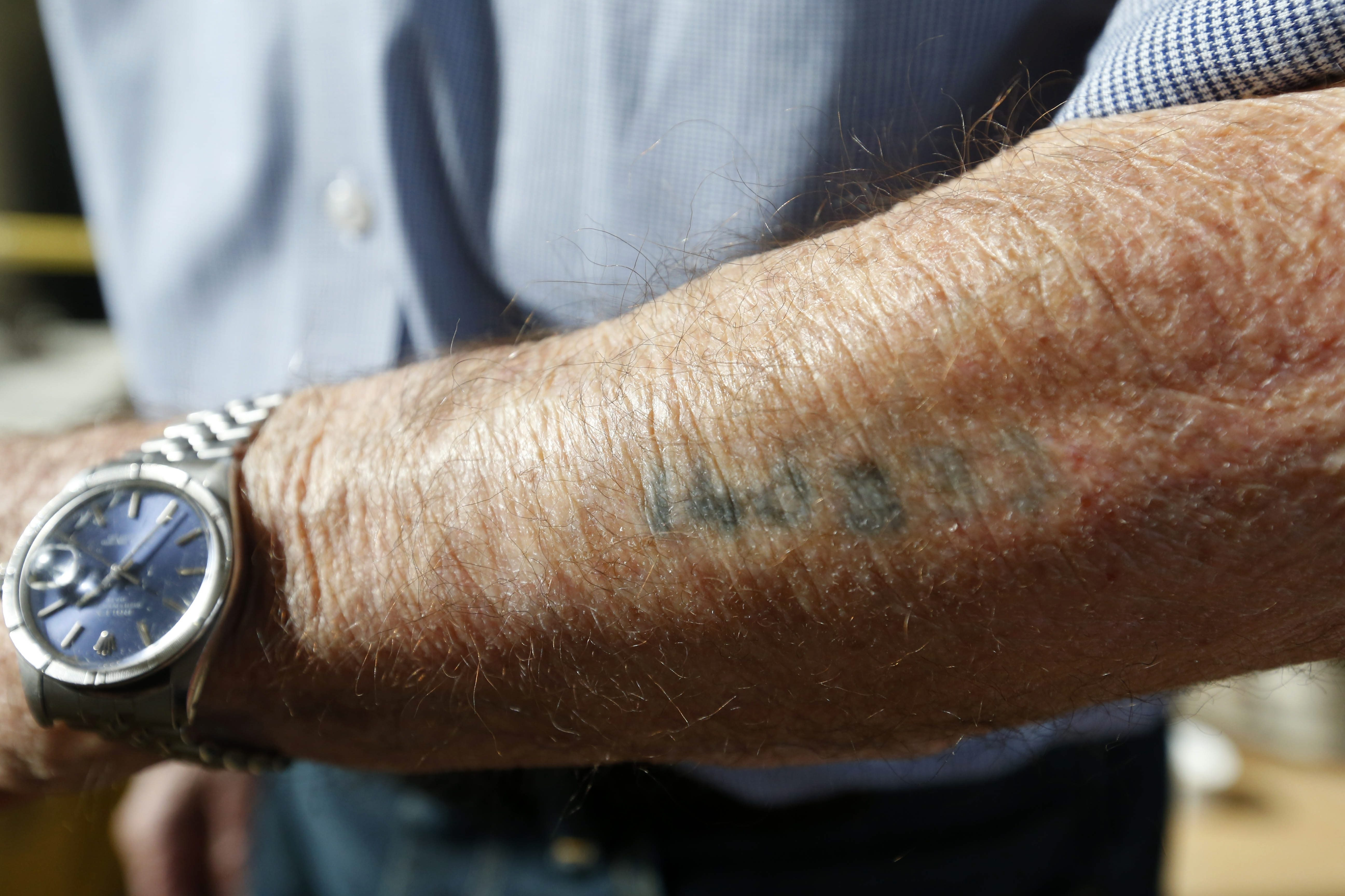 Henry Bawnik's concentration camp tattoo testifies to his narrow escape.