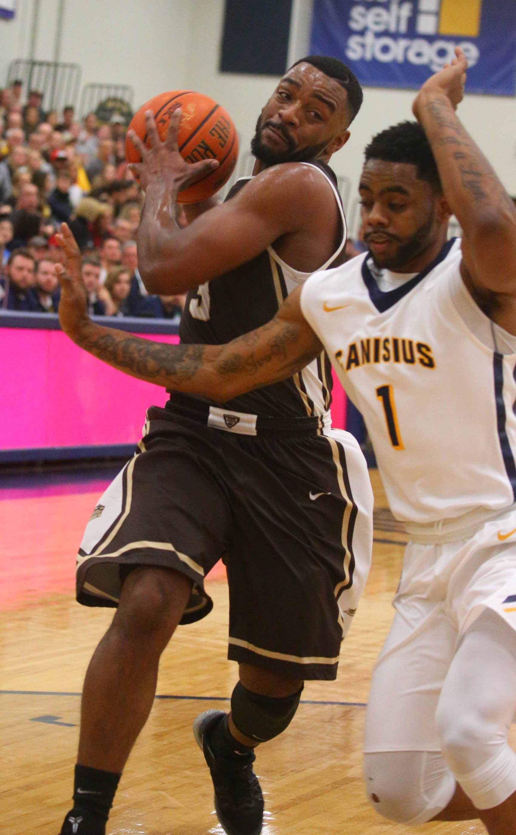 St. Bonaventure's Marcus Posley (3) drives in and around Canisius defender Malcolm McMillan (1) in first half of men's college basketball at Koessler Center, in Buffalo, N.Y., on Tuesday,  Nov. 24, 2015.Canisius 38, St. Bonaventure 41, at the half.  (John Hickey/Buffalo News)