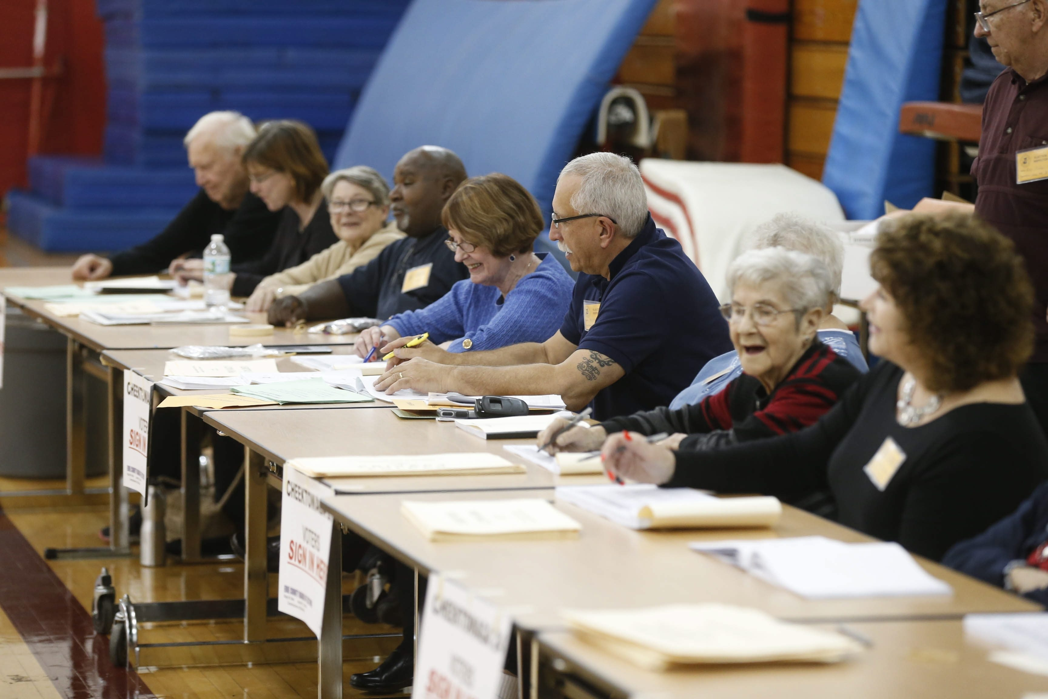 Election inspectors – including these at Maryvale High School in Cheektowaga – were at the ready Nov. 3, but less than a quarter of the county's registered voters bothered to show up. (Robert Kirkham/Buffalo News)