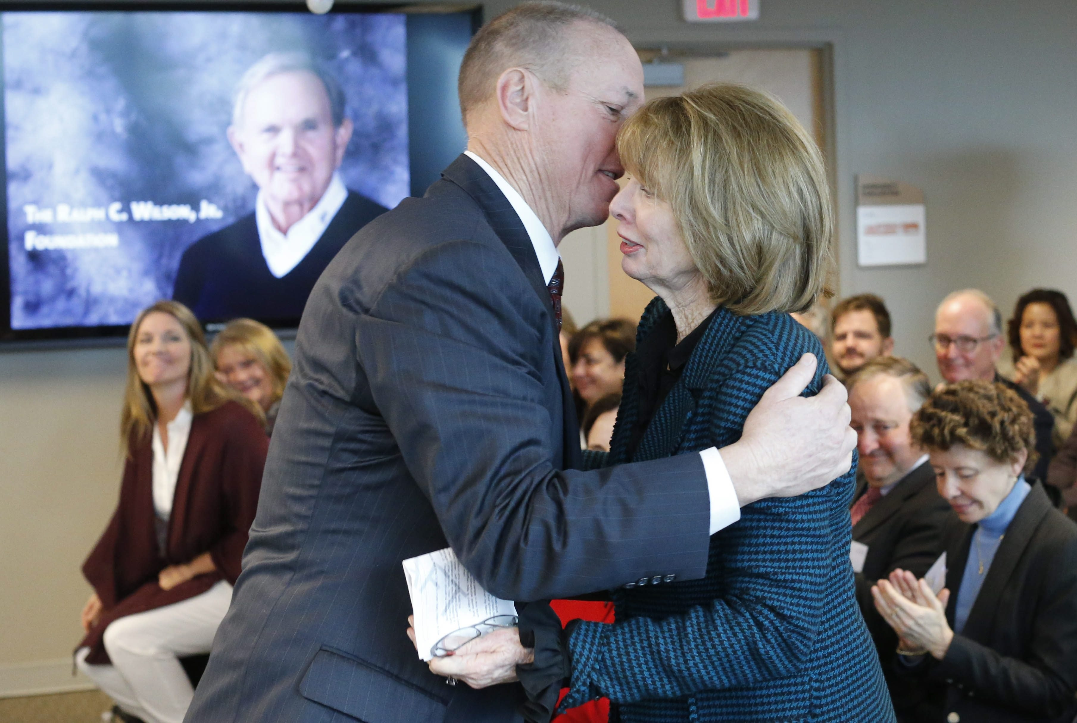 Jim Kelly hugs Mary Wilson during the announcement of the Ralph C. Wilson Jr. Foundation's new awards and a new philanthropic partnership with the Community Foundation for Greater Buffalo on Tuesday, Nov. 24, 2015.  (Derek Gee/Buffalo News)