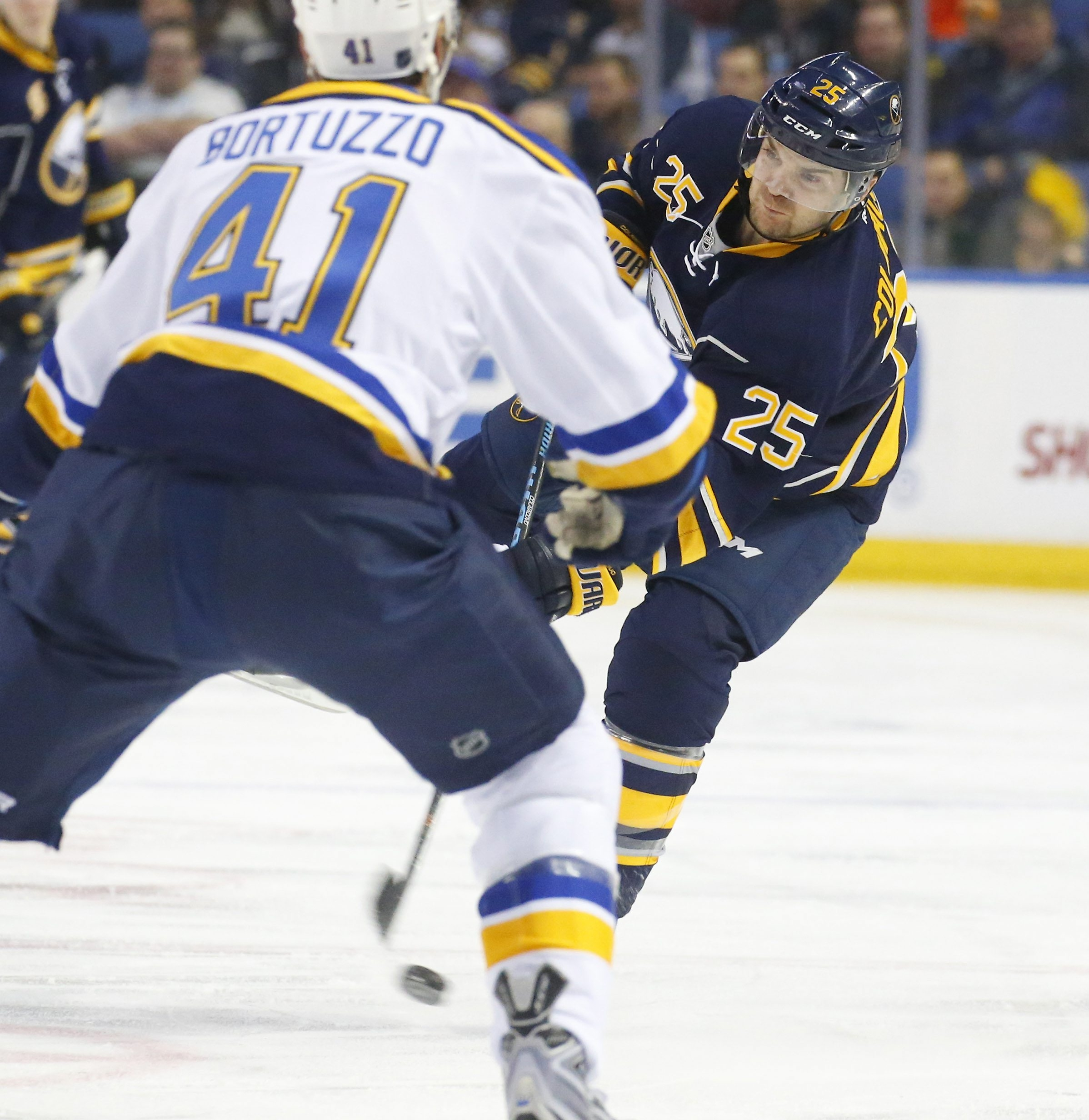 Sabres' Carlo Colaiacovo dumps the puck in the first period at the First Niagara Center.