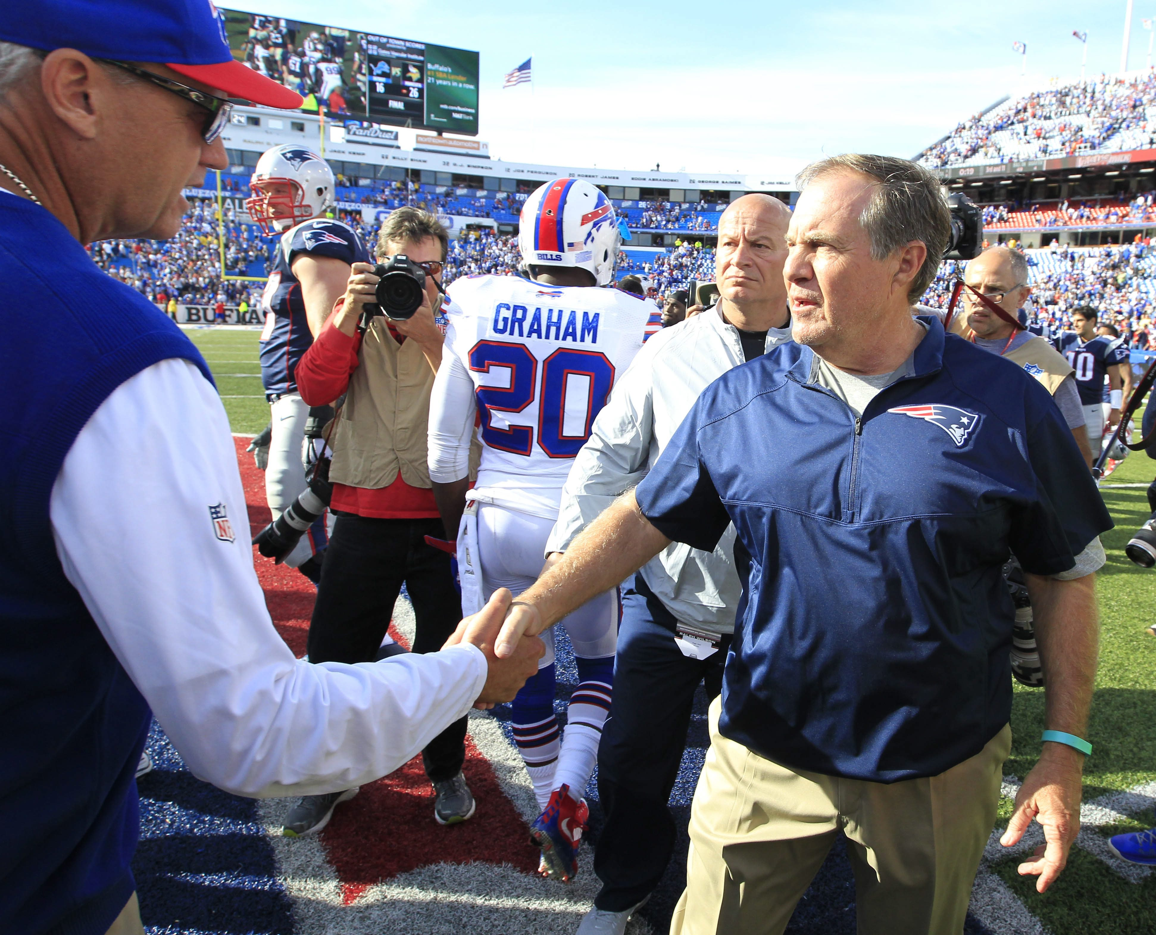 Rex Ryan shakes hands with New England Patriots coach Bill Belichick after the Patriots' win in Week Two of the 2015 season. (Harry Scull Jr./Buffalo News)
