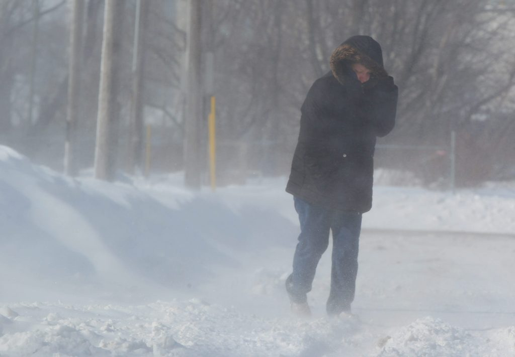 Jennifer Monroe braves the cold winds and blowing snow on Mackinaw St in Buffalo Tuesday, February 3, 2015. (Mark Mulville/Buffalo News)