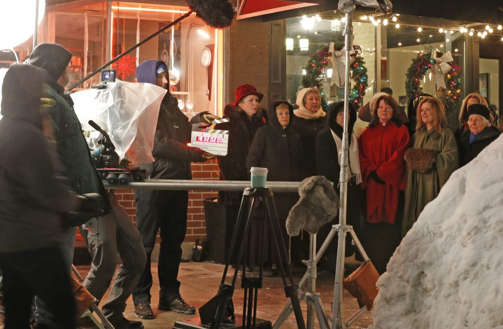 """Actors sing """"Silent Night"""" during filming in front of Viddler's during the production of hollywood movie """"Small Town Prince"""" on Thursday, Feb. 26, 2015. (Robert Kirkham/Buffalo News)"""