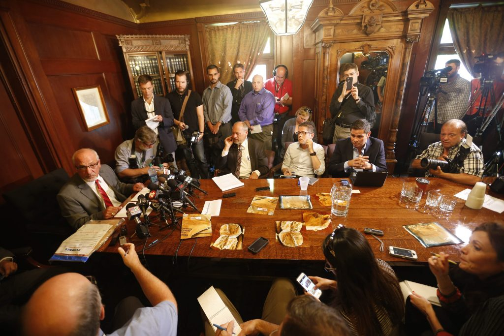"""Attorney Thomas Eoannou announces that the evidence bag which contained the """"rape kit"""" collected from the Patrick Kane accuser was left at the doorstep of the victim's mother yesterday during a press conference in his office at the Cornell Mansion in Buffalo, Wednesday, Sept. 23, 2015. (Photo by Derek Gee / Buffalo News)"""
