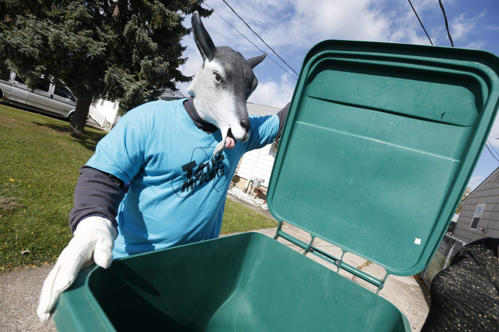 Niagara Falls garbage mascot Totes McGoats displays one of the city's garbage totes in this 2015 file photo. (Robert Kirkham/Buffalo News file photo)