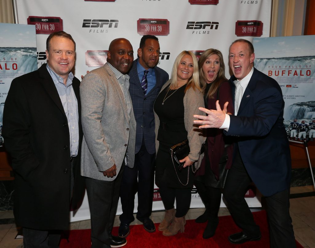 Jim Kelly, Thurman Thomas, Andre Reed and Steve Tasker ham it up on the red carpet for the opening of ESPN's '30 for 30' documentary of the Super Bowl era Buffalo Bills at North Park theater in Buffalo, N.Y. on Wednesday, Dec. 9, 2015. (James P. McCoy/ Buffalo News)