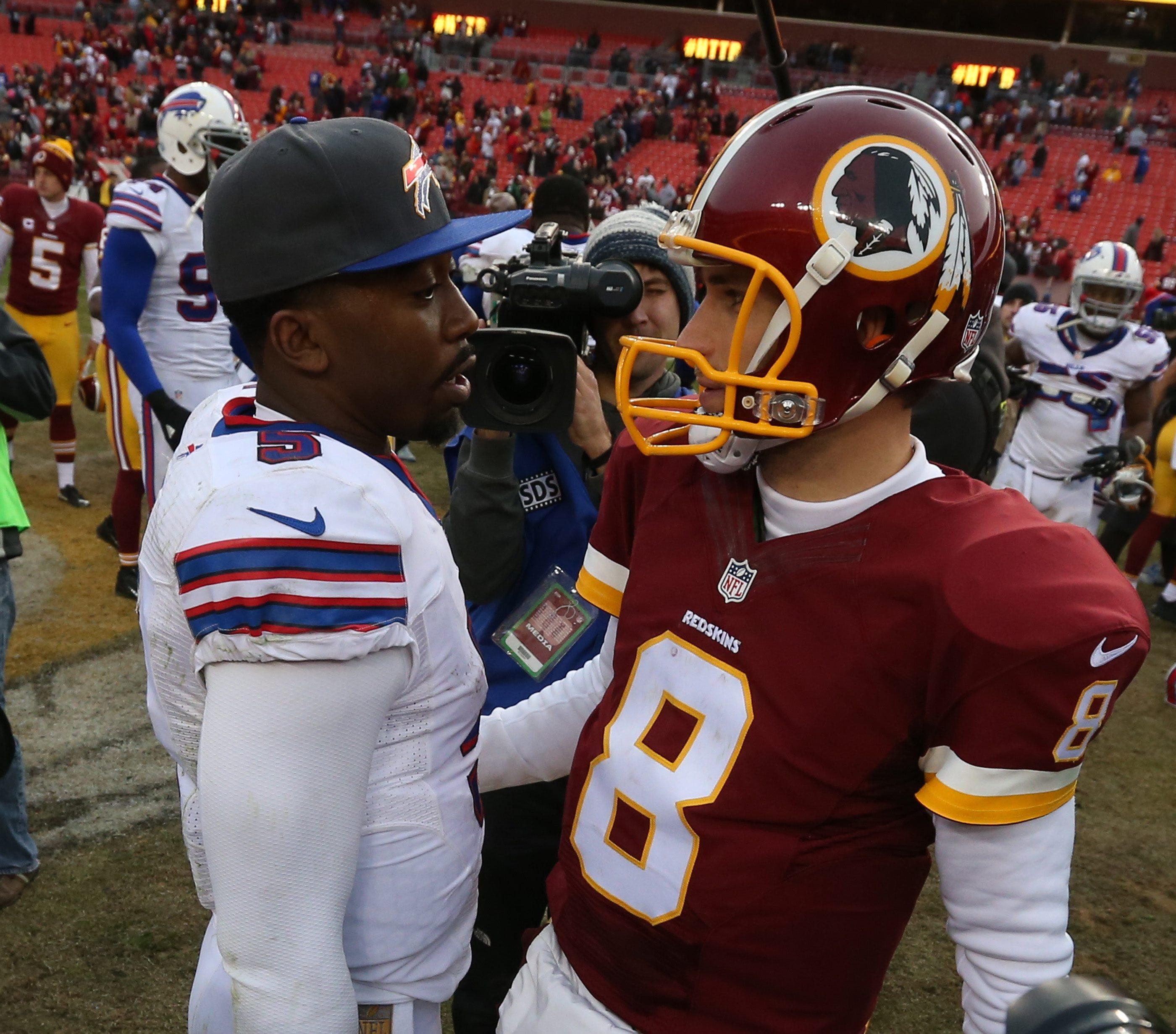 Buffalo Bills quarterback Tyrod Taylor (5) and Washington Redskins quarterback Kirk Cousins (8) shake hands after the game.  (James P. McCoy/ Buffalo News)