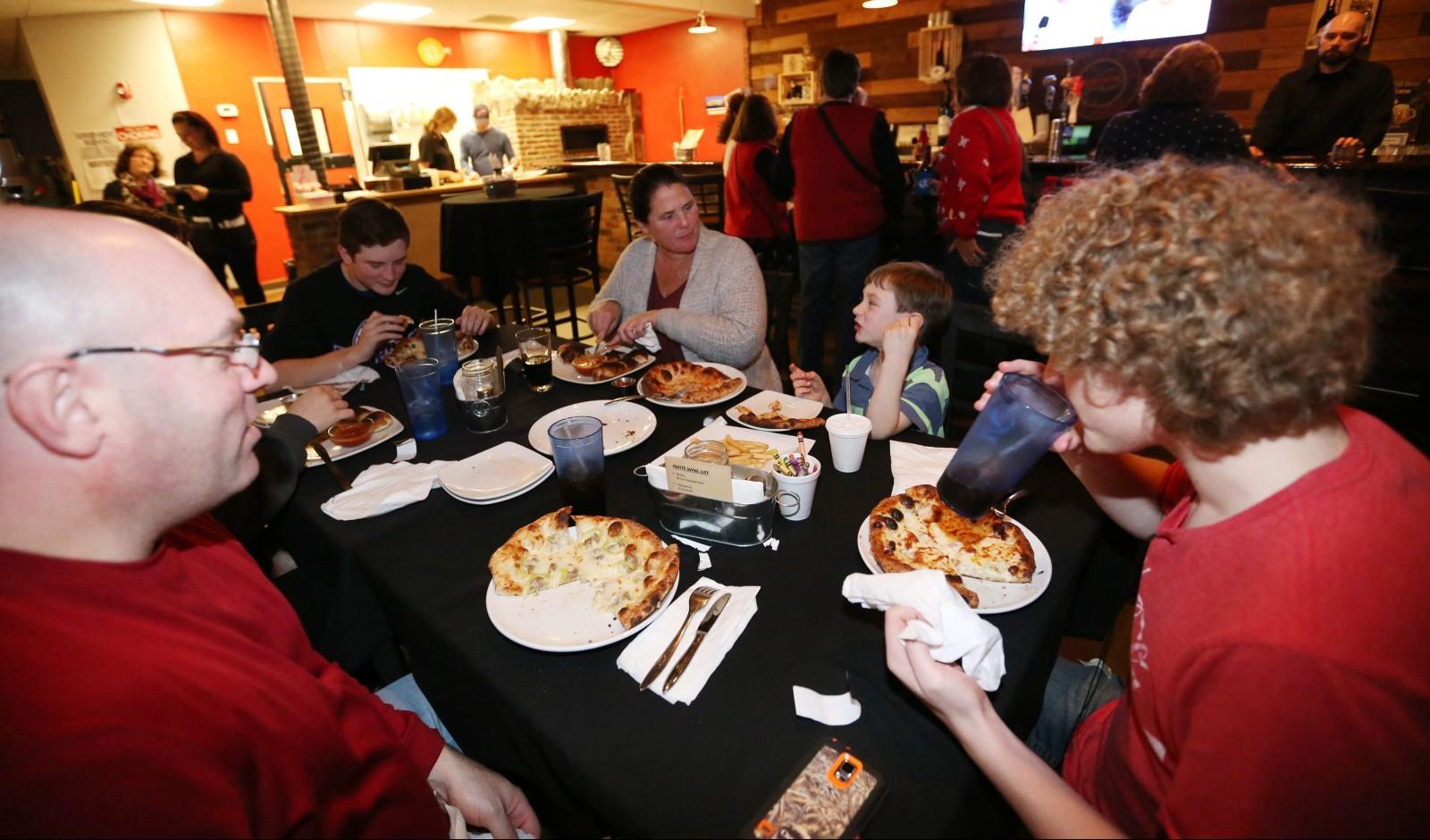 The Miller family of Hamburg has dinner at Butera's. See a photo gallery at buffalonews.com