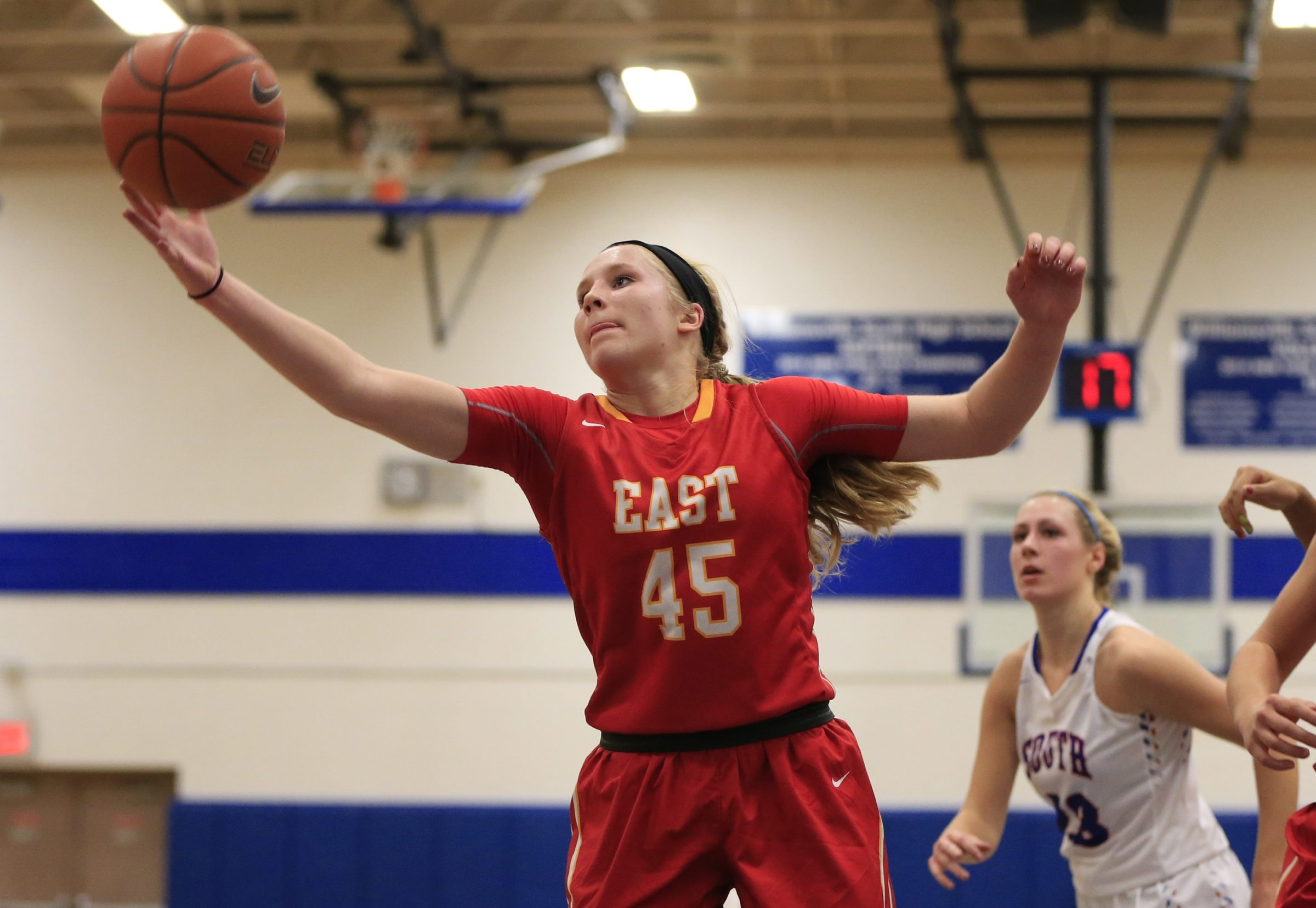Erica Martinsen of Williamsville East takes down a rebound against Williamsville South in Tuesday's ECIC II season opener.