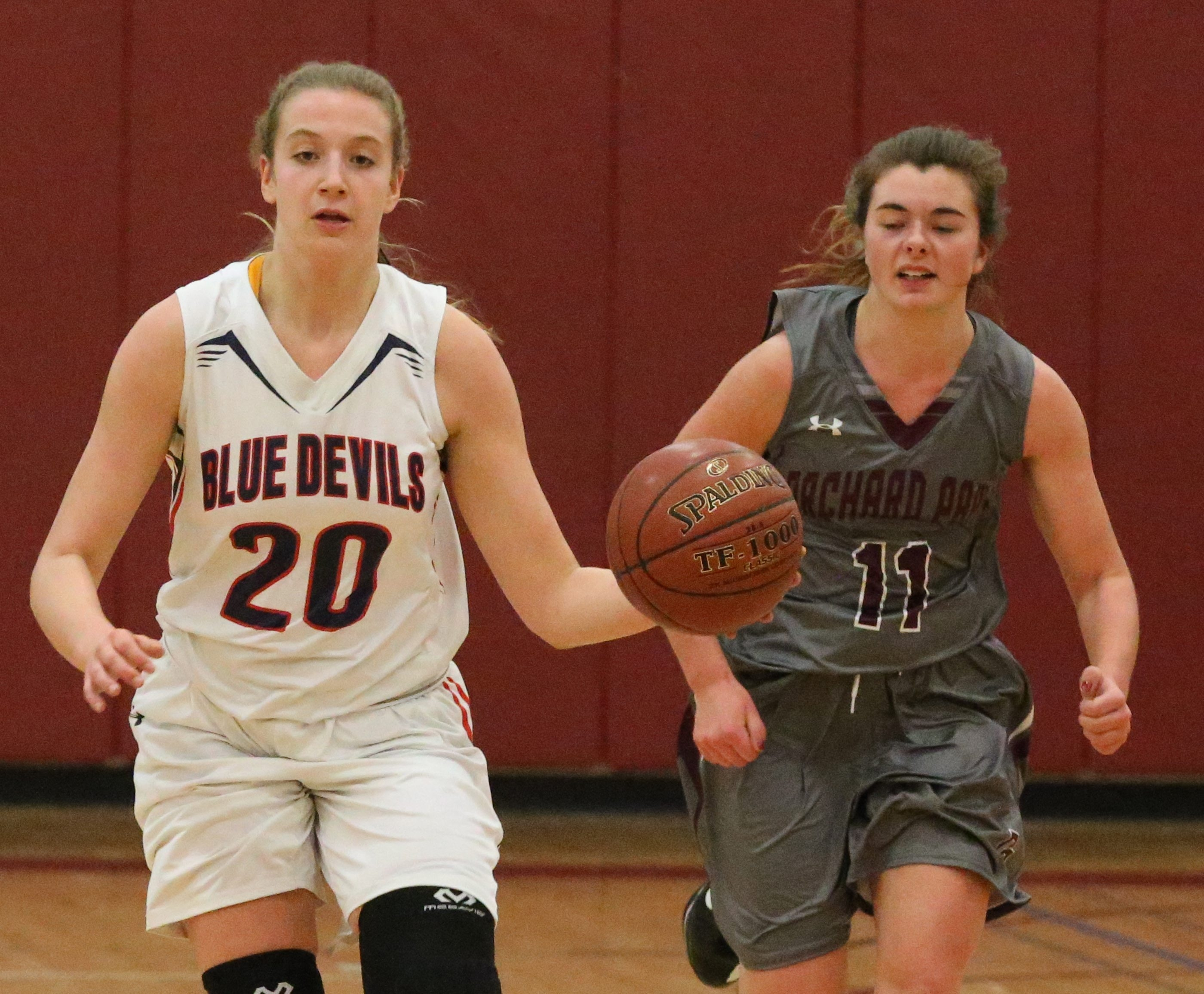 East Aurora's Emma Brinker dribbles the ball up court for the Blue Devils. She earned MVP honors while helping East Aurora win the Orchard Park Tournament on Wednesday.