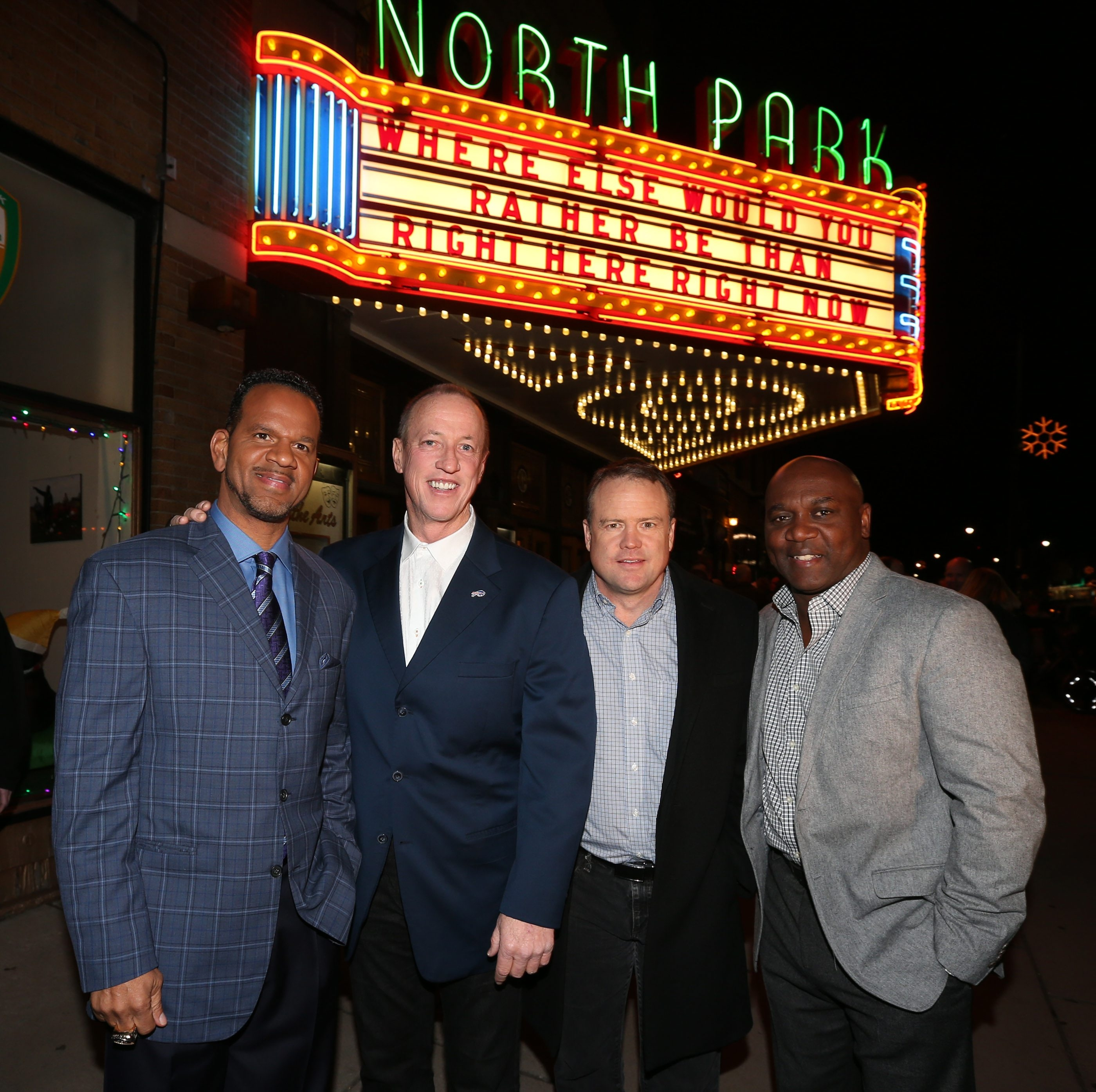 """From left, Andre Reed, Jim Kelly, Steve Tasker and Thurman Thomas stand shoulder to shoulder outside the North Park Theatre, where the world premiere was held Wednesday night for ESPN's film, """"Four Falls of Buffalo.""""  , Andre Reed and Steve Tasker ham it up on the red carpet for the opening of ESPN's '30 for 30' documentary  of the Super Bowl era Buffalo Bills at North Park theater in Buffalo, N.Y. on Wednesday, Dec. 9, 2015."""