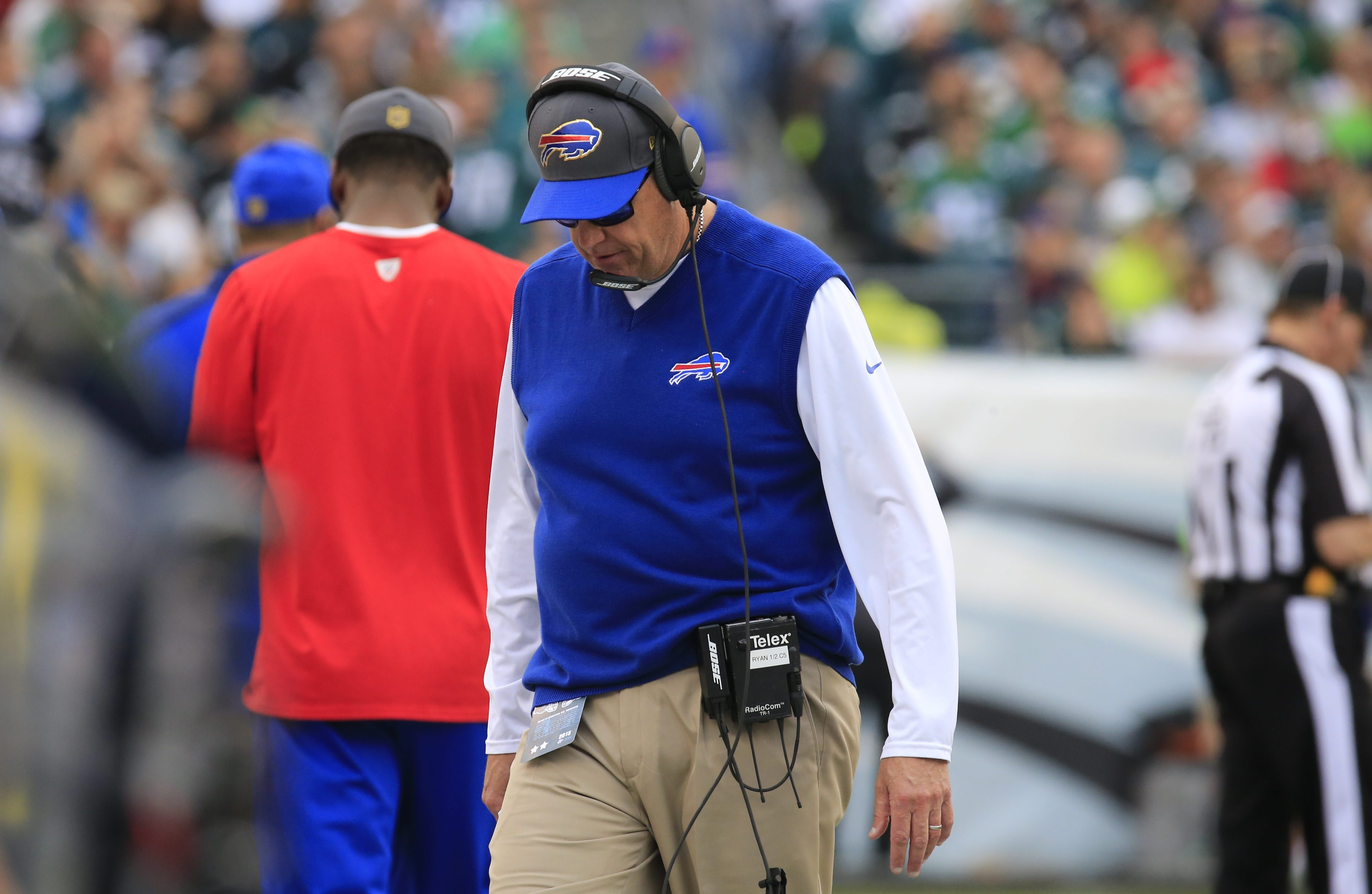 Bills coach Rex Ryan walks with his head down after a penalty was called against his team during the first half. The team's undisciplined play is a major reason why it will likely be watching the playoffs on TV.