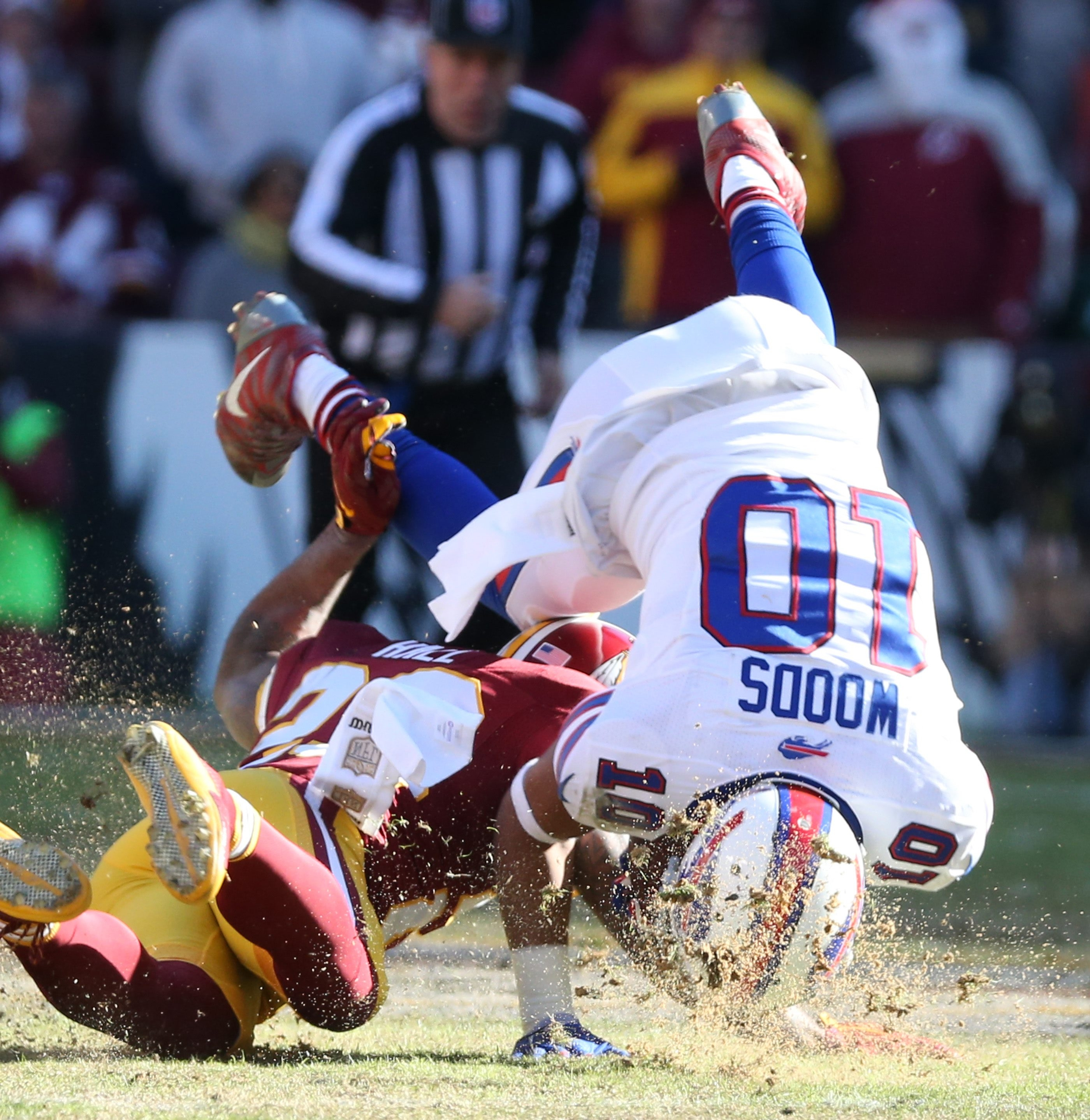 Bills wide receiver Robert Woods tumbles while making a catch against Redskins cornerback DeAngelo Hall during the third quarter. Woods finished with four catches for 44 yards.   in the third quarter at Fed Ex field in Landover, Md on Sunday, Dec. 20, 2015.  (James P. McCoy/ Buffalo News)