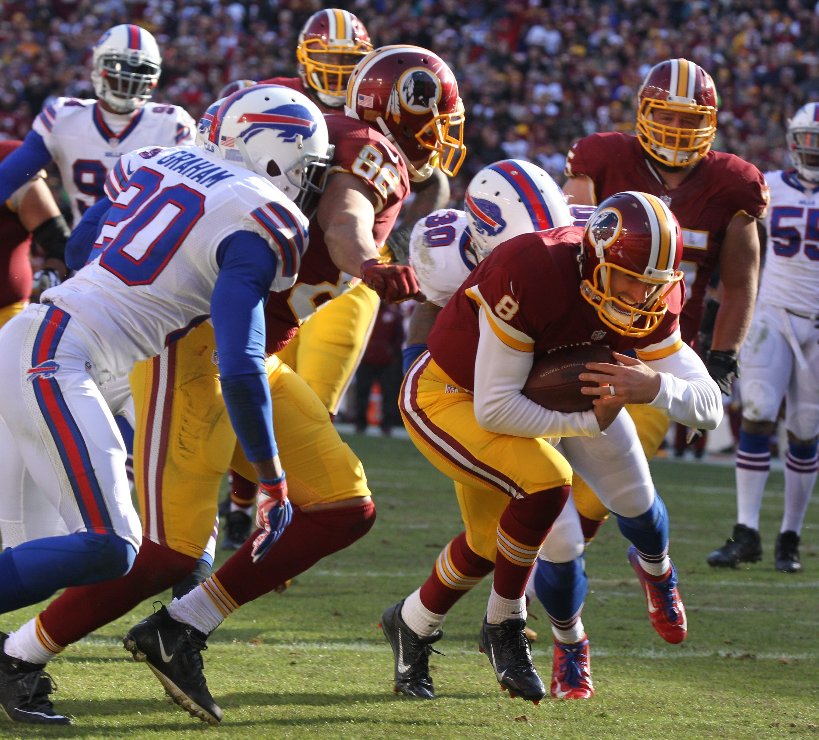 1LINE CUTLINE Washington Redskins quarterback Kirk Cousins rushes for touchdown in the second quarter at Fed Ex field in Landover, Md on Sunday, Dec. 20, 2015.  (James P. McCoy/ Buffalo News)