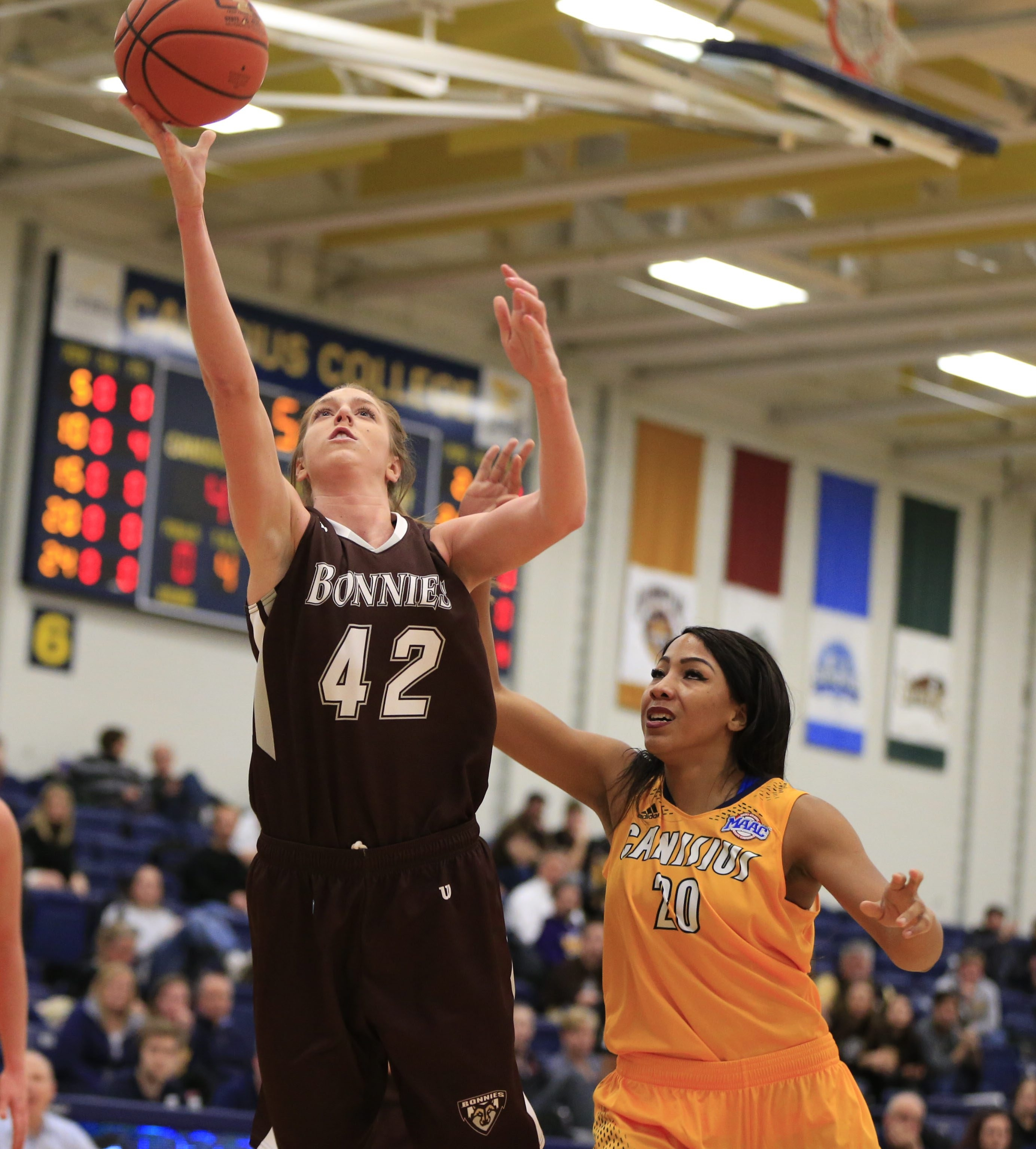 St. Bonaventure's Katie Healy drives past Jasmine Mungo to score in the first half Tuesday night at the Koessler Center.