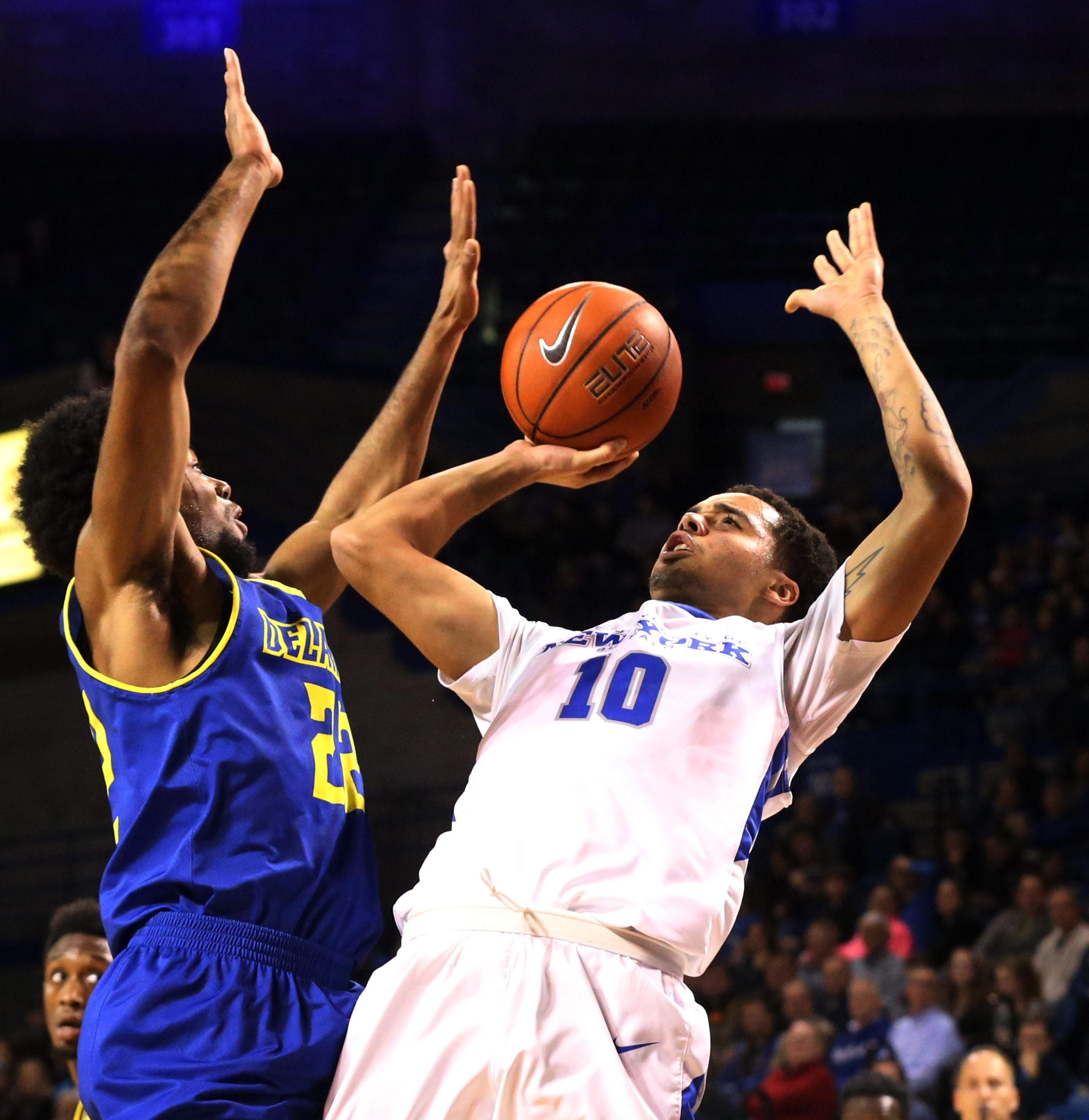 Jarryn Skeete of UB puts up two of his 20 points against Delaware's Cazmon Hayes.
