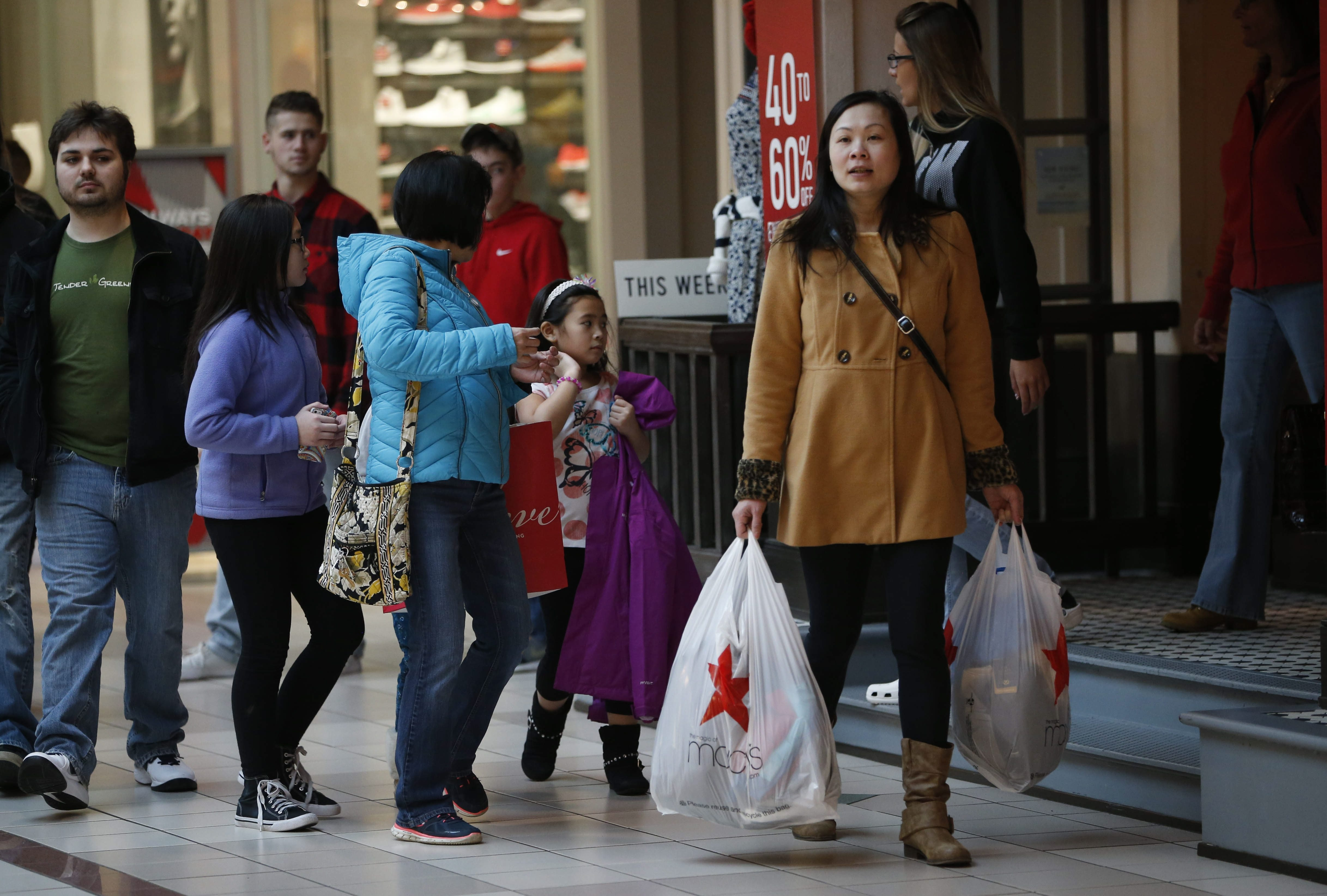 Shoppers return items and search for deals Saturday, the day after Christmas, at the Boulevard Mall