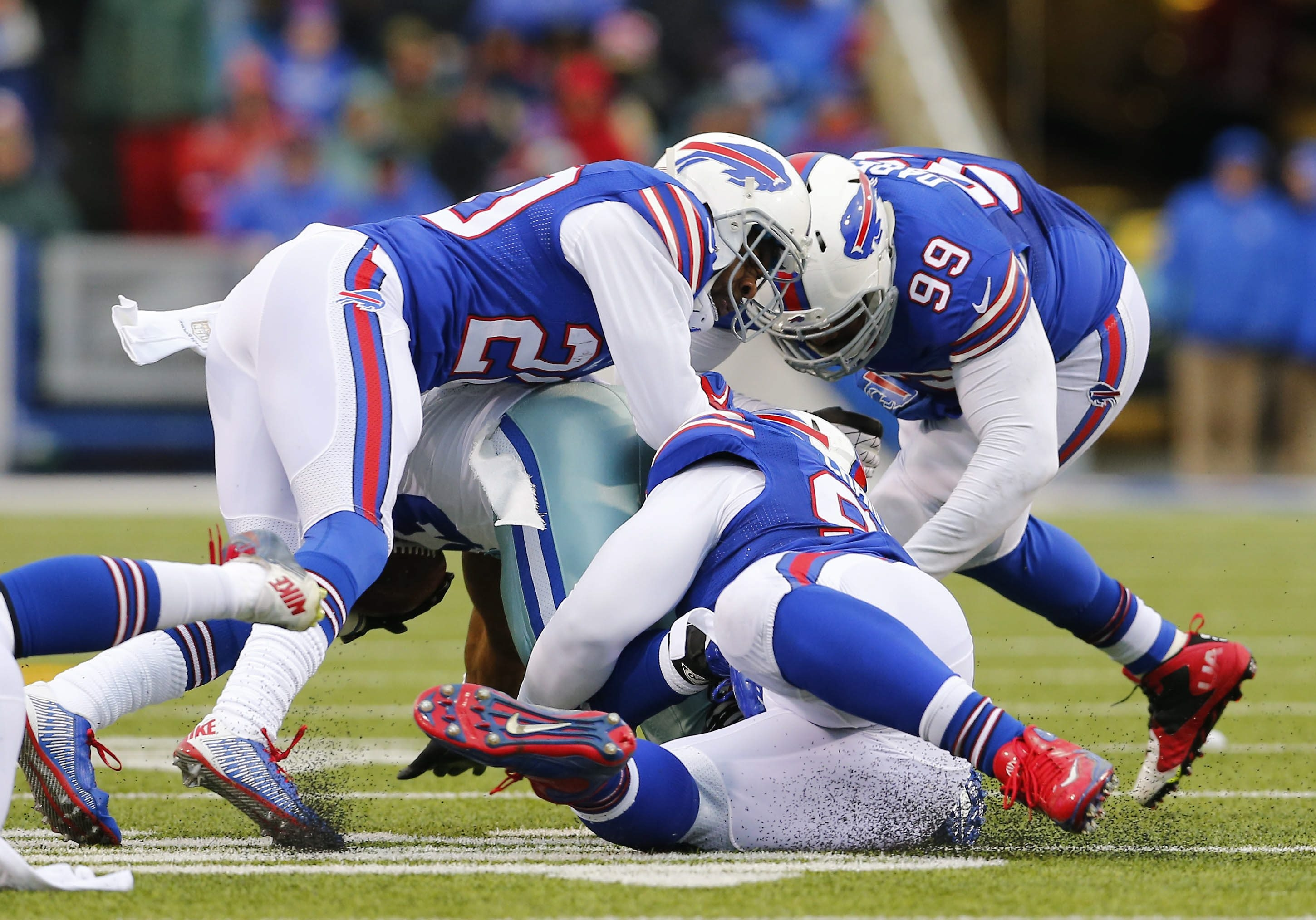 Bills defensive tackle Marcell Dareus (99) is in on the tackle of Cowboys running back Robert Turbin during the second quarter. Dareus left with a neck injury and did not return.