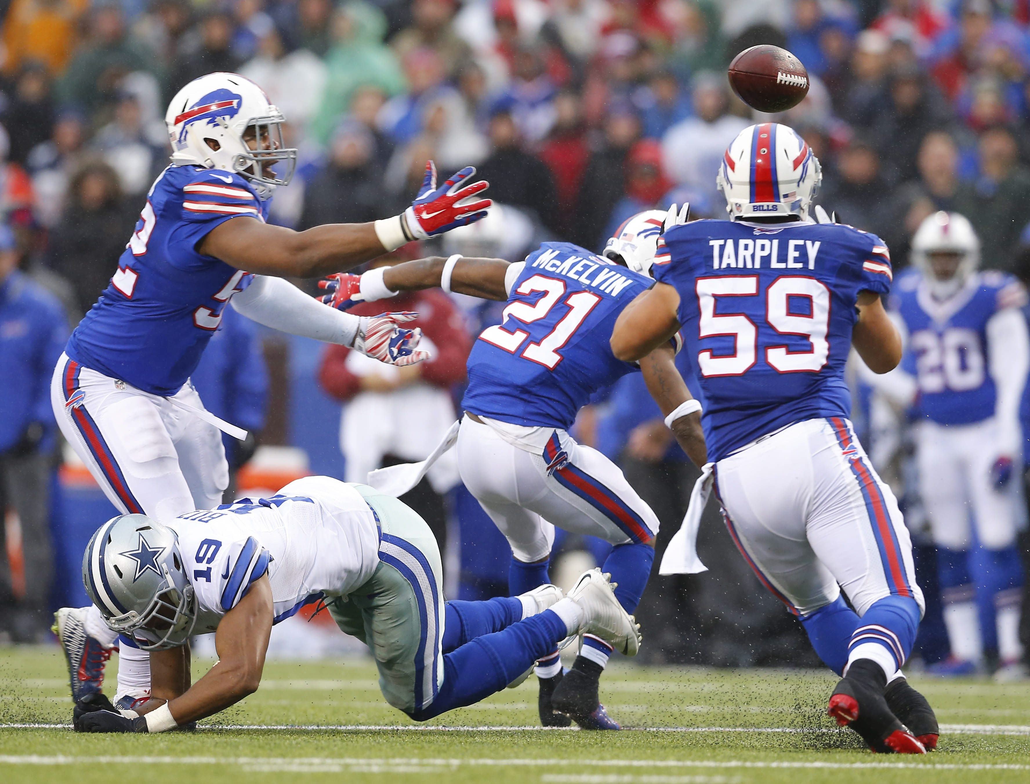 The Bills' AJ Tarpley intercepts a pass intended for the Cowboys' Brice Butler in the third quarter of the game in Orchard Park Sunday, December 27, 2015.  (Mark Mulville/Buffalo News)