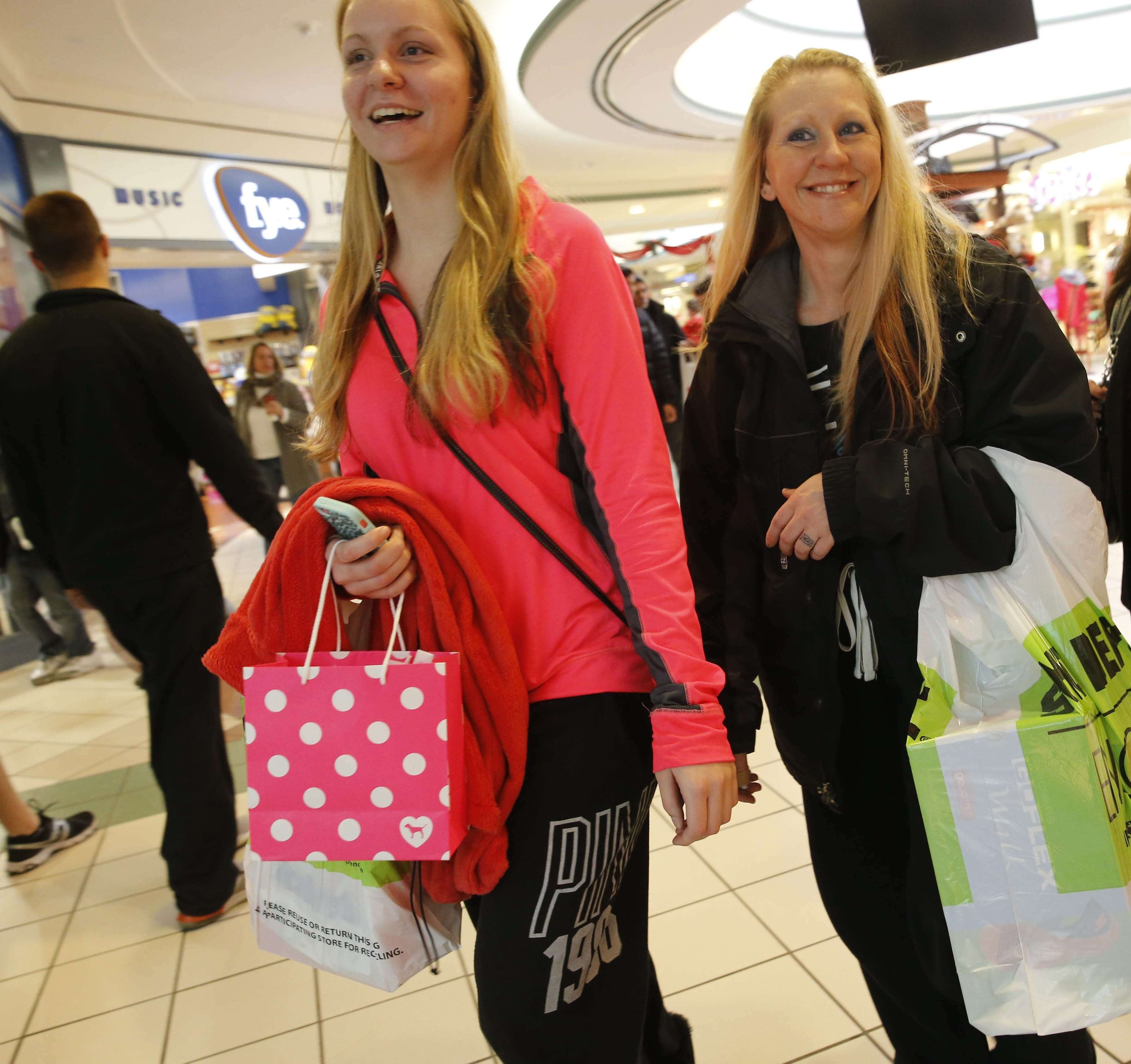 Alexis Bower, left, and her mother, Karrie Bower, of Getzville, shop at the Boulevard Mall on Saturday. Although many people were returning gifts bought online, many others were spending gift cards and sniffing out sales at area stores.