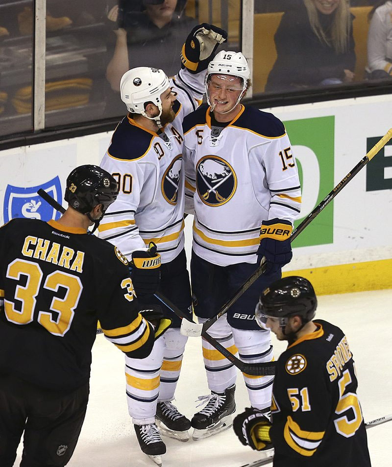 Ryan O'Reilly, left, and Jack Eichel congratulate each other after O'Reilly's empty-net goal wrapped up the Sabres' win over the Bruins.