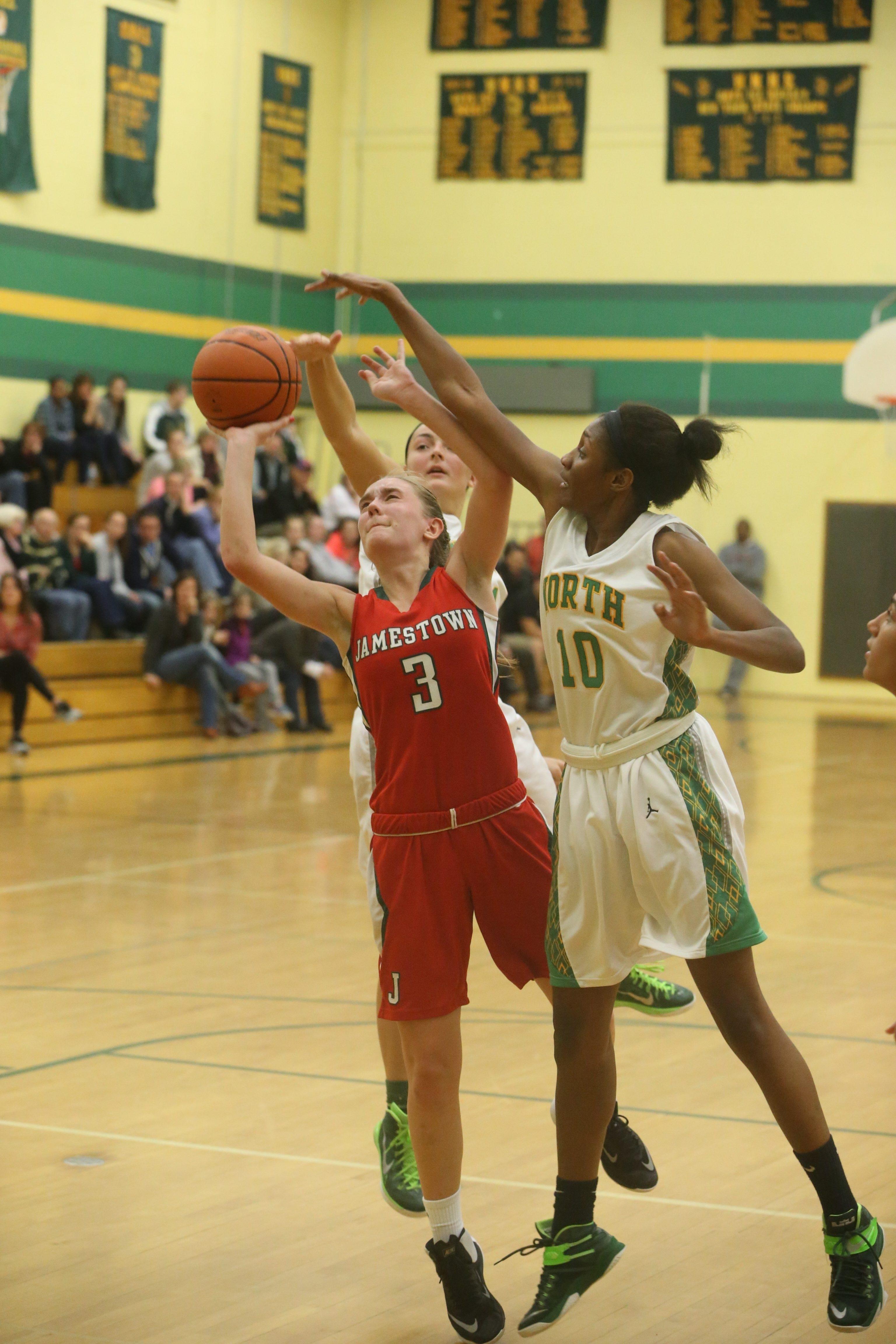 Jamestown's Kate Tucker gets a shot off between Williamsville North's Ericka Taplin, right, and Clare Ahern. Williamsville North won, 33-31.