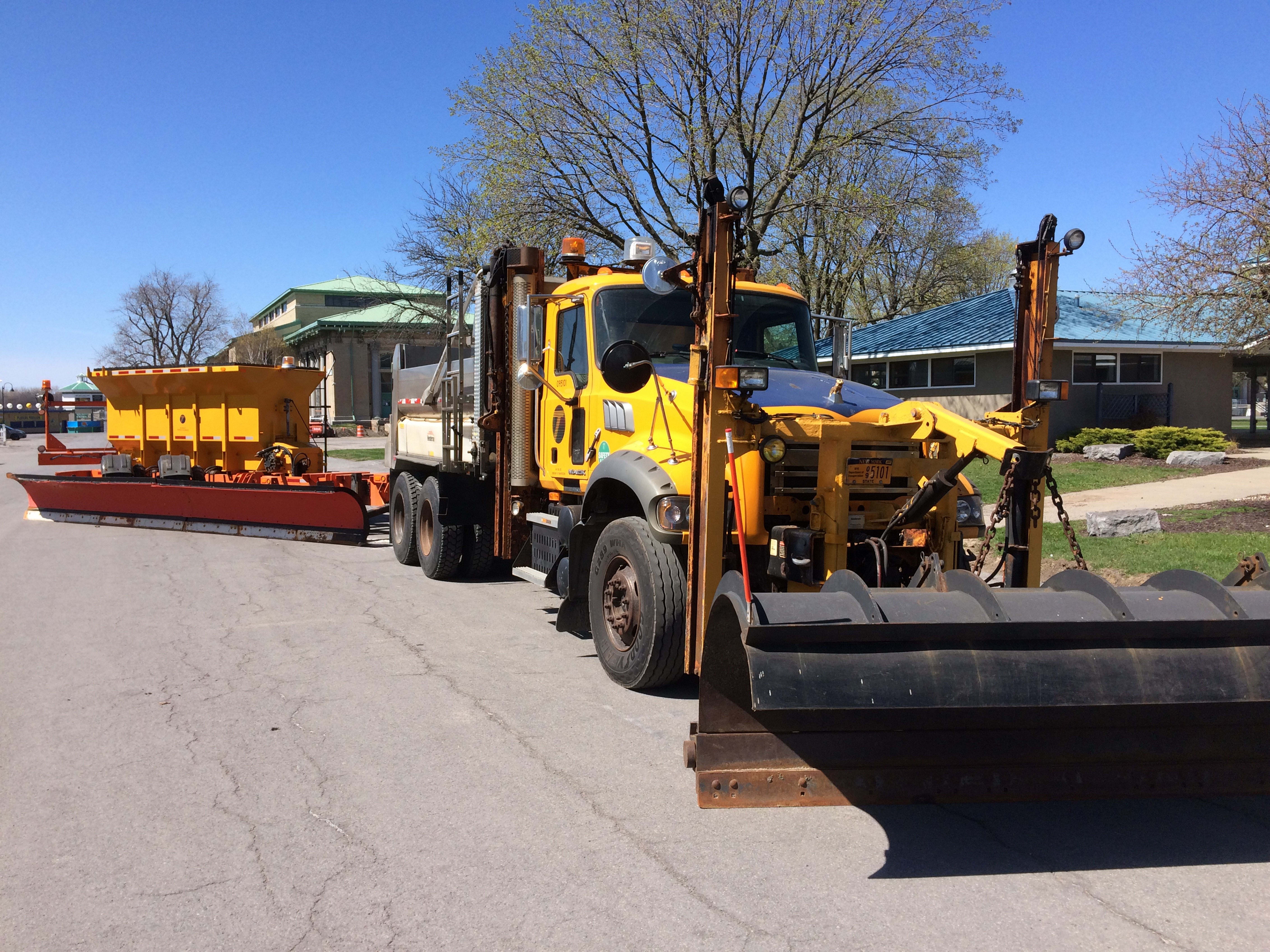 "State DOT showcases one of its ""tow plows"" at Evangola State Park. The add-on doubles snowplowing width, clearing two lanes at once."