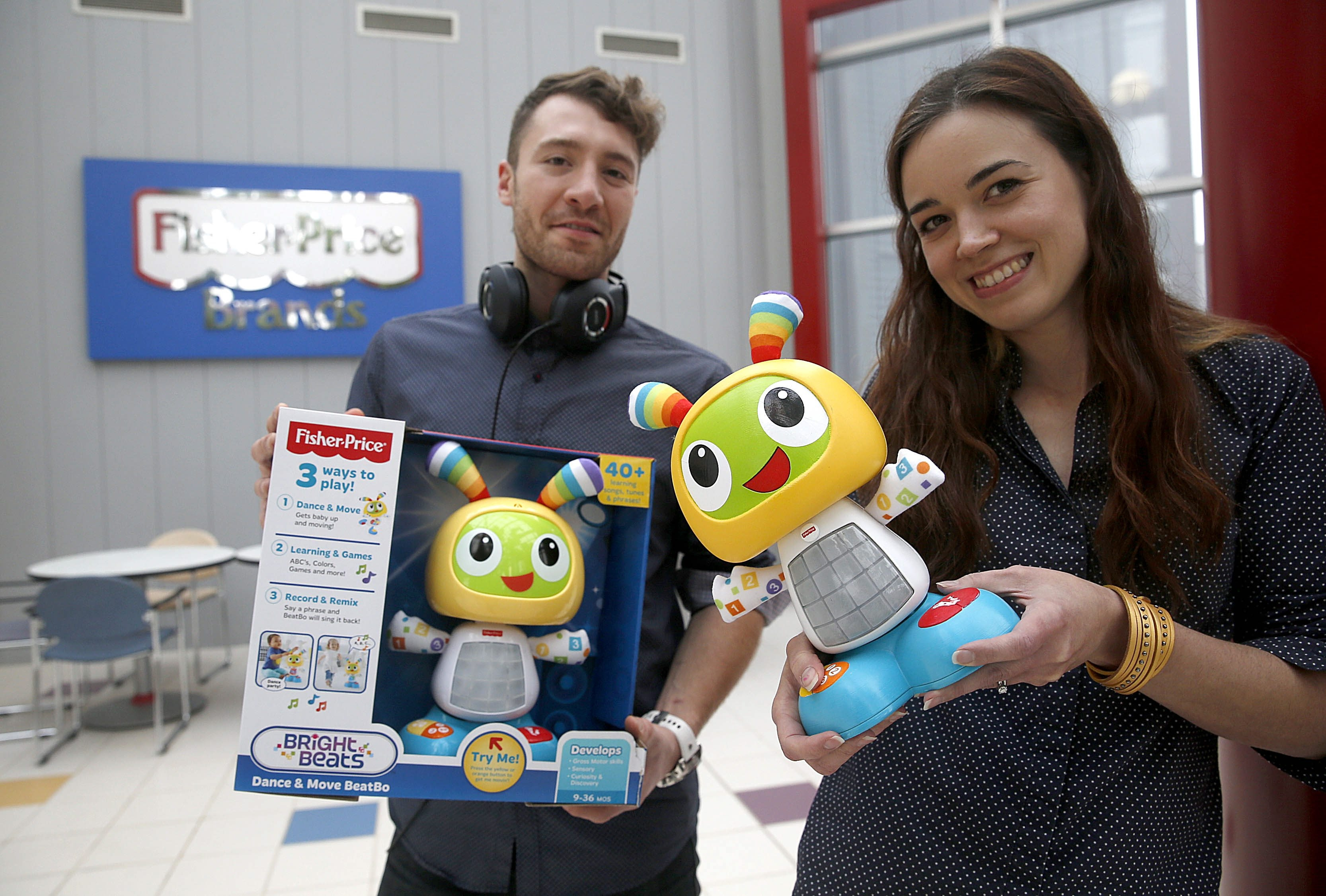 """Fisher-Price staff designer Beth Hageman, holding the original concept model, and project audio engineer Chris Grabar have a hit on their hands in  the Bright Beats Dance & Move """"Beatbo."""" (Robert Kirkham/Buffalo News)"""