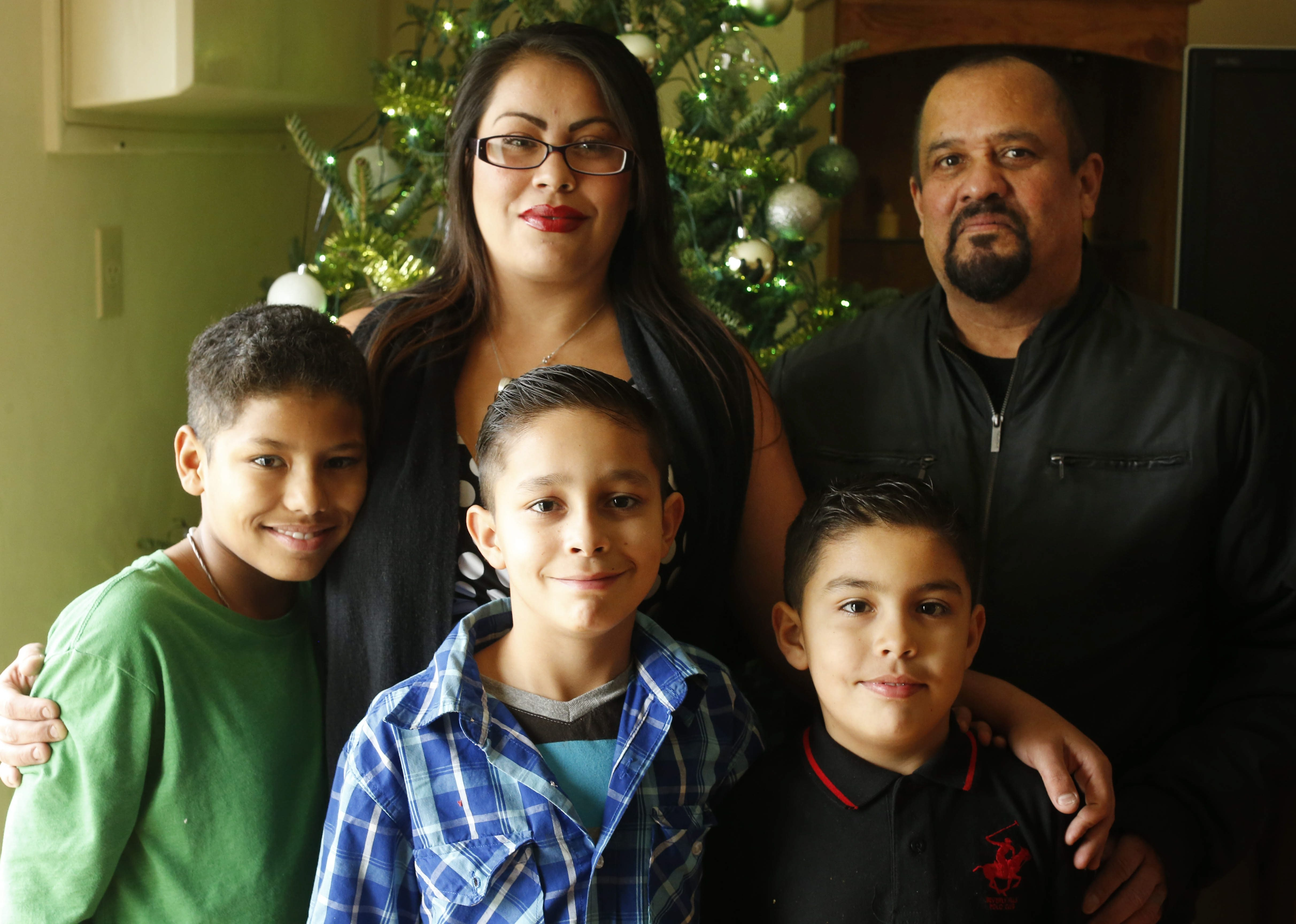 Benjamin and Michelle Galvan with their sons, Jayden, 12, Joshua, 10, and Benjamin Jr., 9, are ready to celebrate Christmas in their Depew apartment.