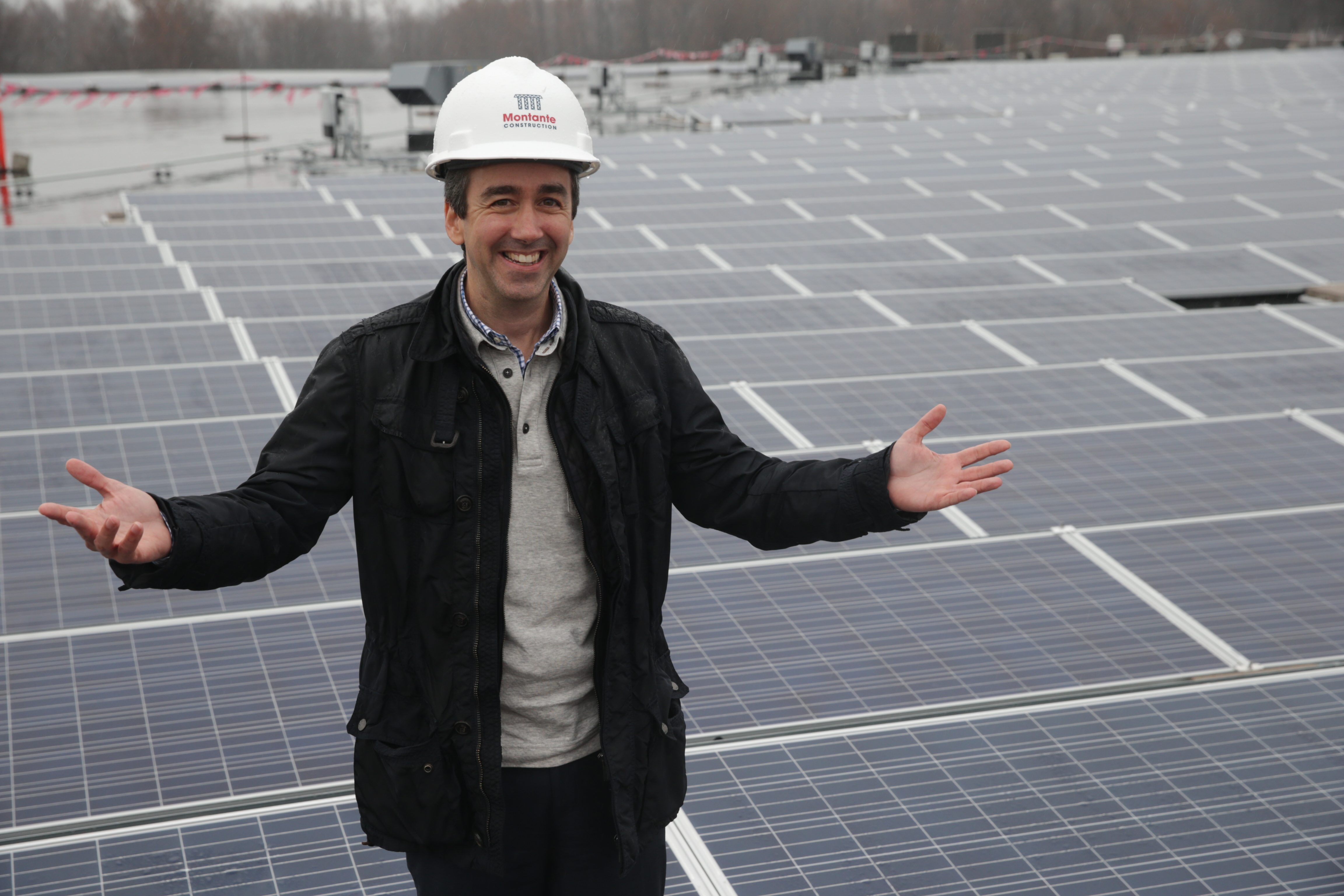 "Daniel Montante, president and co-founder of Montante Solar, says  that Congress' expansion of the tax credit is ""a win-win across the board."" He is shown at the FedEx distribution center's solar array in the Town of Tonawanda."""