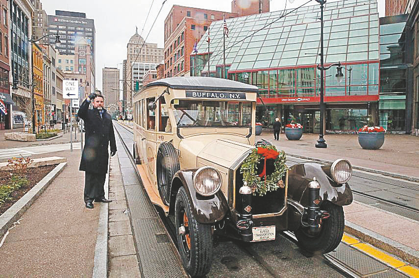 A vintage Pierce-Arrow bus helped reopen the 500 block of Main Street to traffic.