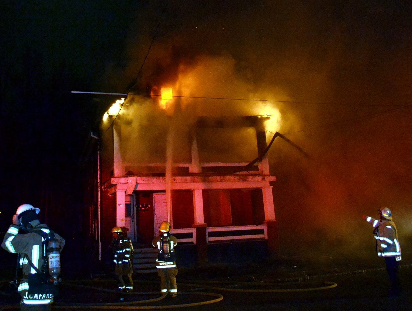 Niagara Falls firefighters respond to a structure fire on 19th Street in the city Dec. 19. (LARRY KENSINGER/CONTRIBUTOR)