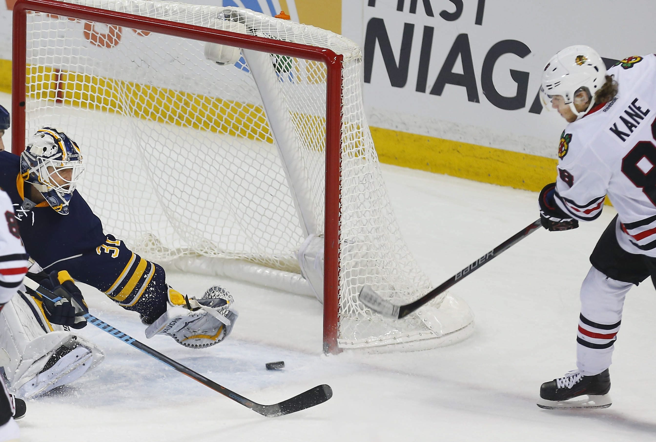 The Blackhawks' Patrick Kane beats the Sabres' Chad Johnson for the game-tying goal on Saturday.