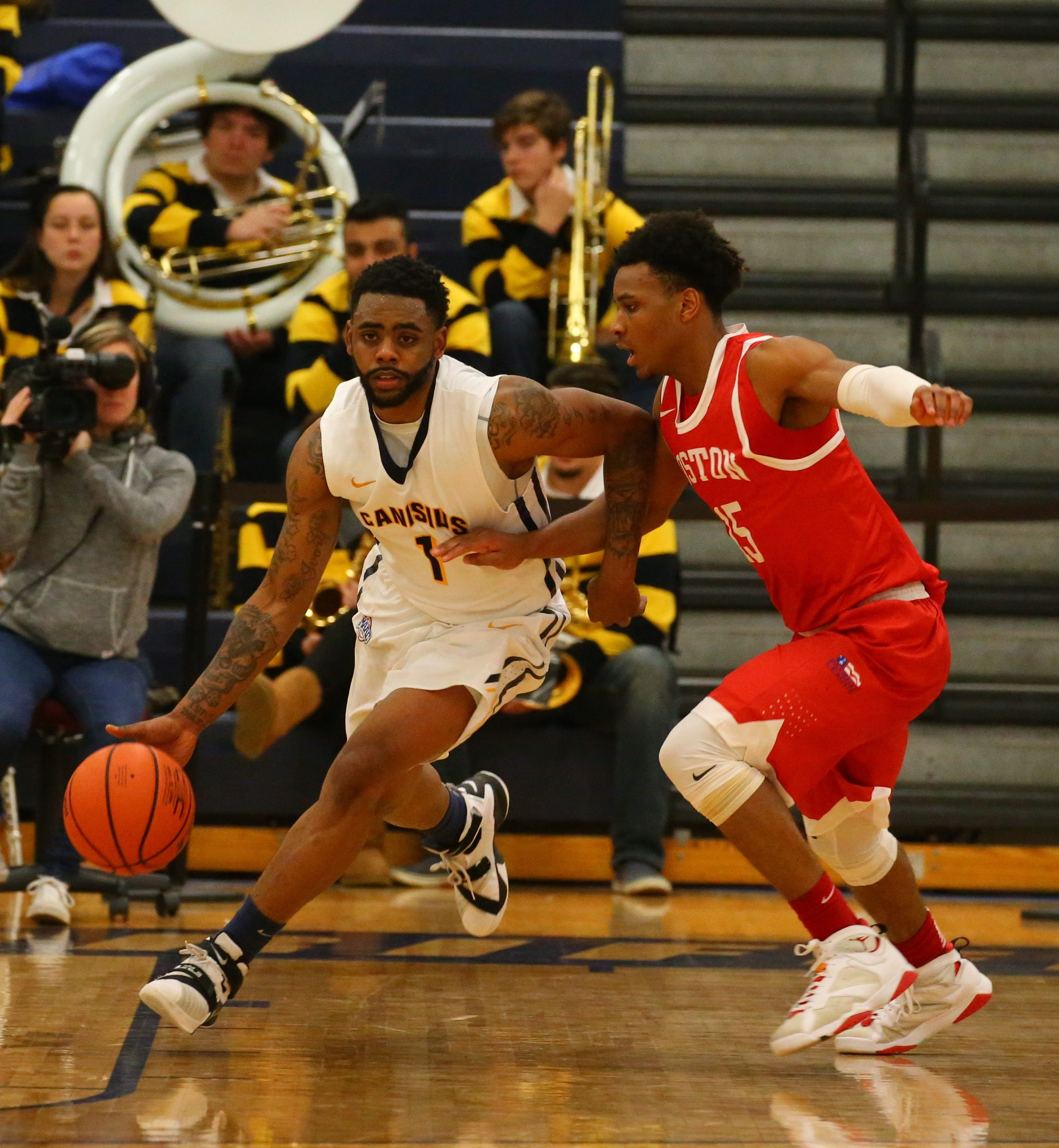 Canisius' Malcolm McMillan works the ball upcourt against Boston University's Cheddi Mosely during Saturday's game at the Koessler Center.
