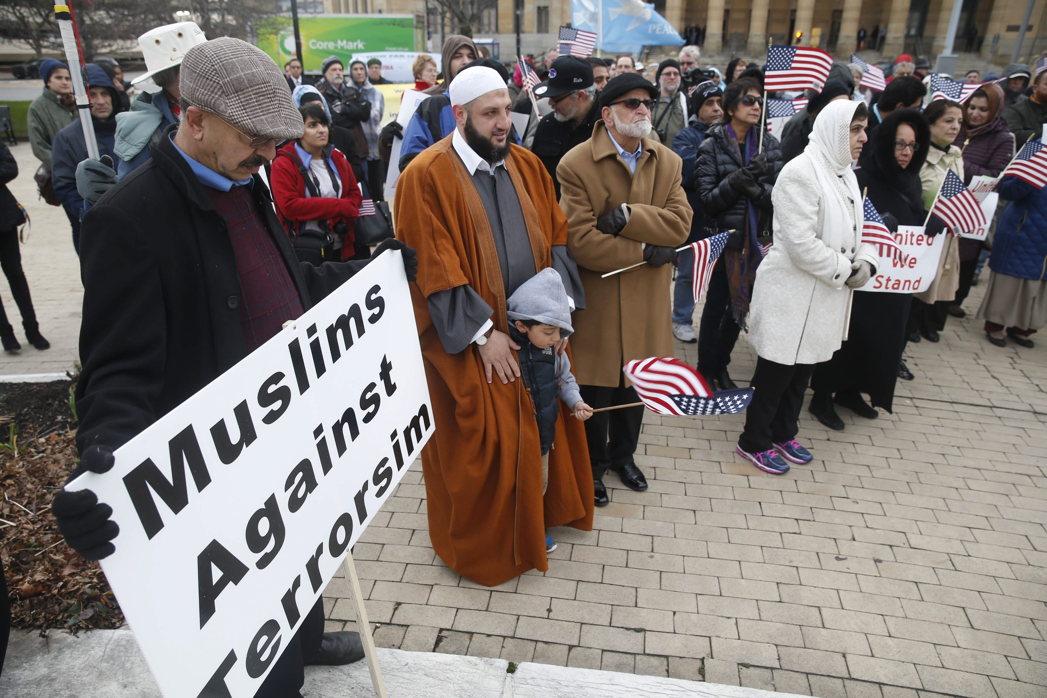 Members of the Muslim community stood together to affirm their civic pride in being Americans, and to stand against terrorism in Niagara Square on Thursday, Dec. 17, 2015.  (Robert Kirkham/Buffalo News)