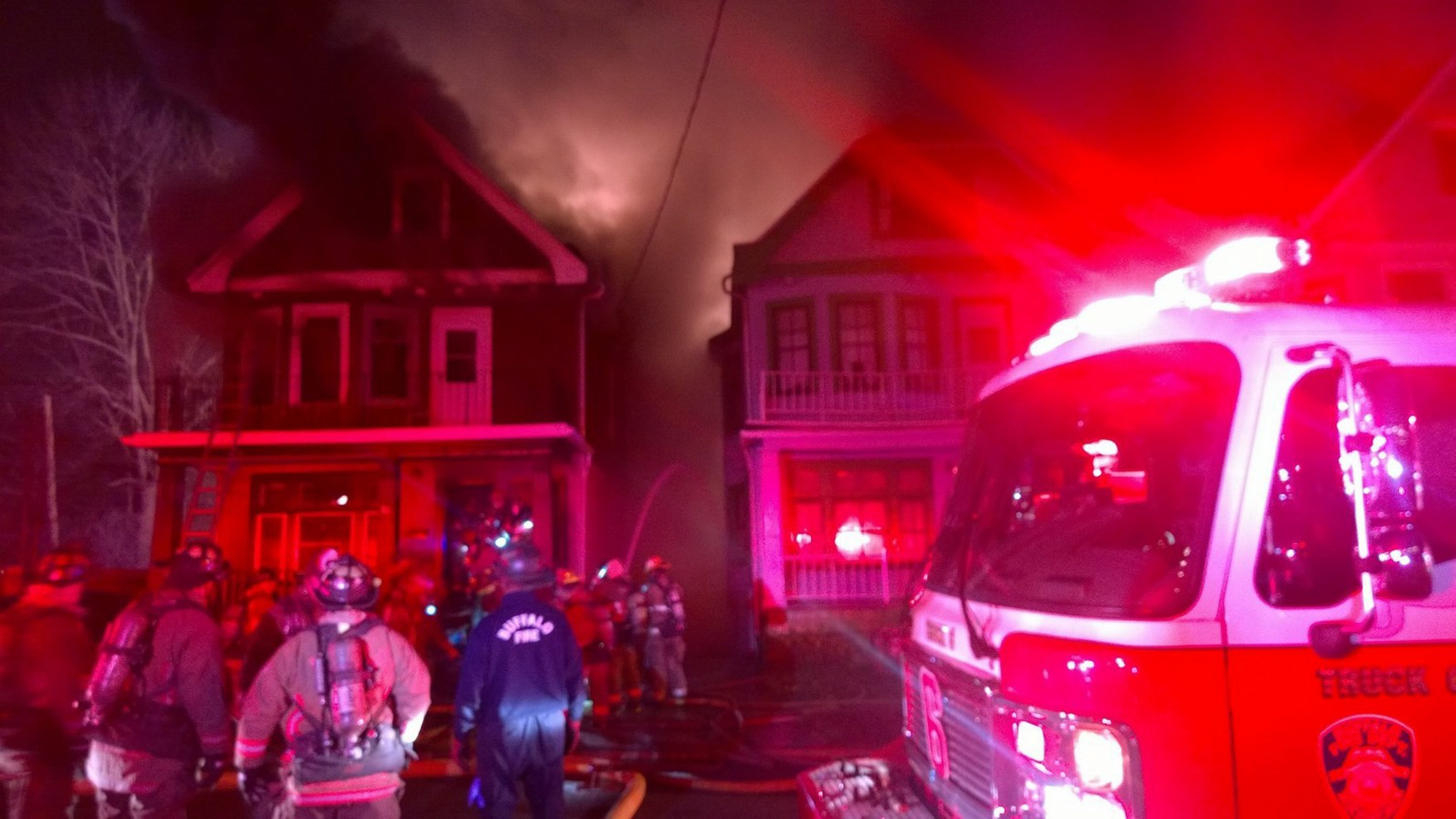 Fire crews battle a blaze on Kilhoffer Street on Buffalo's East Side. (David F. Kazmierczak/Special to the News)