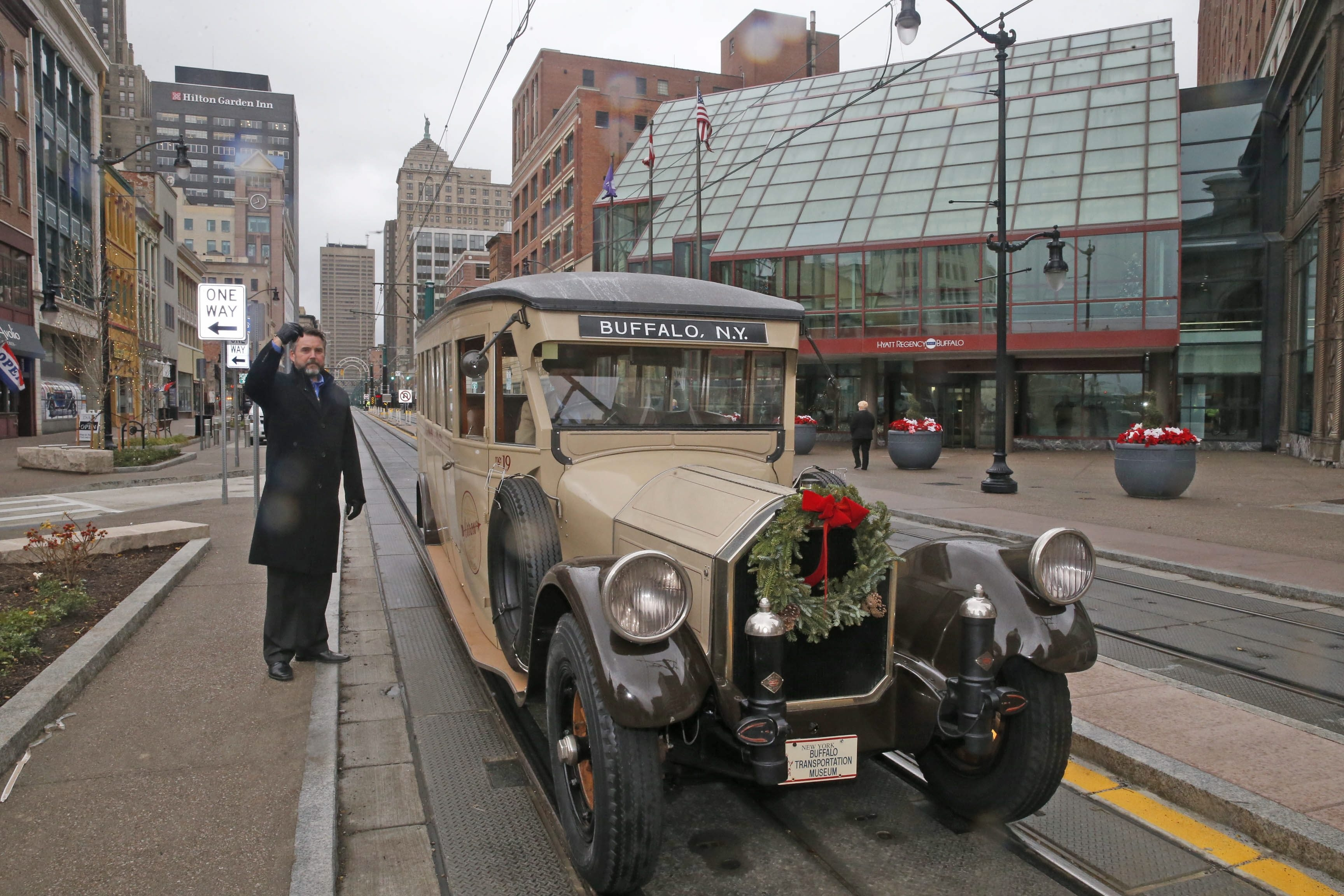 A classic Pierce-Arrow bus was among the first vehicles to drive down the latest reopened section of Main Street on Tuesday.