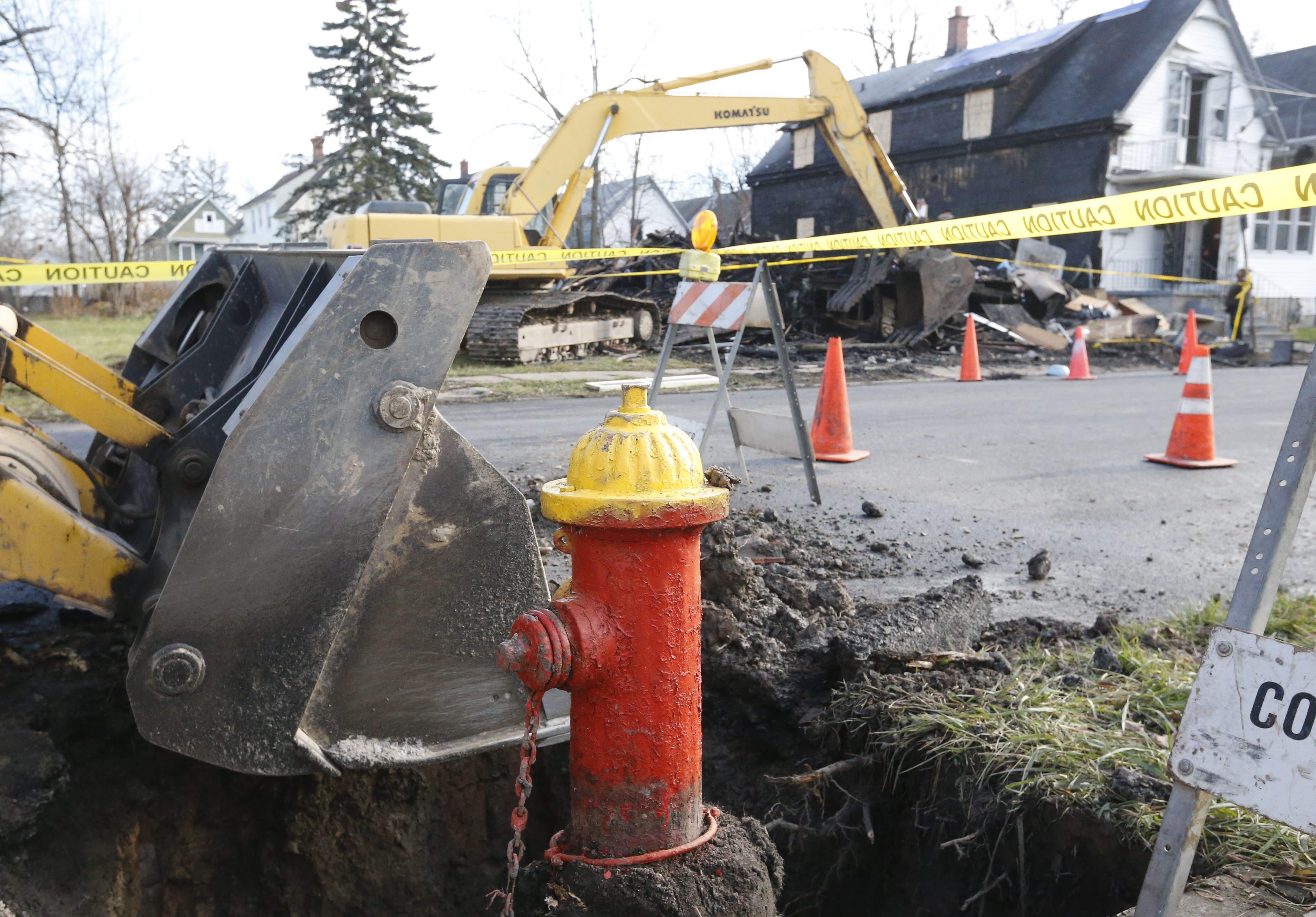 Work has begun on a broken fire hydrant across the street from 55 Nevada Ave. (Derek Gee/Buffalo News)