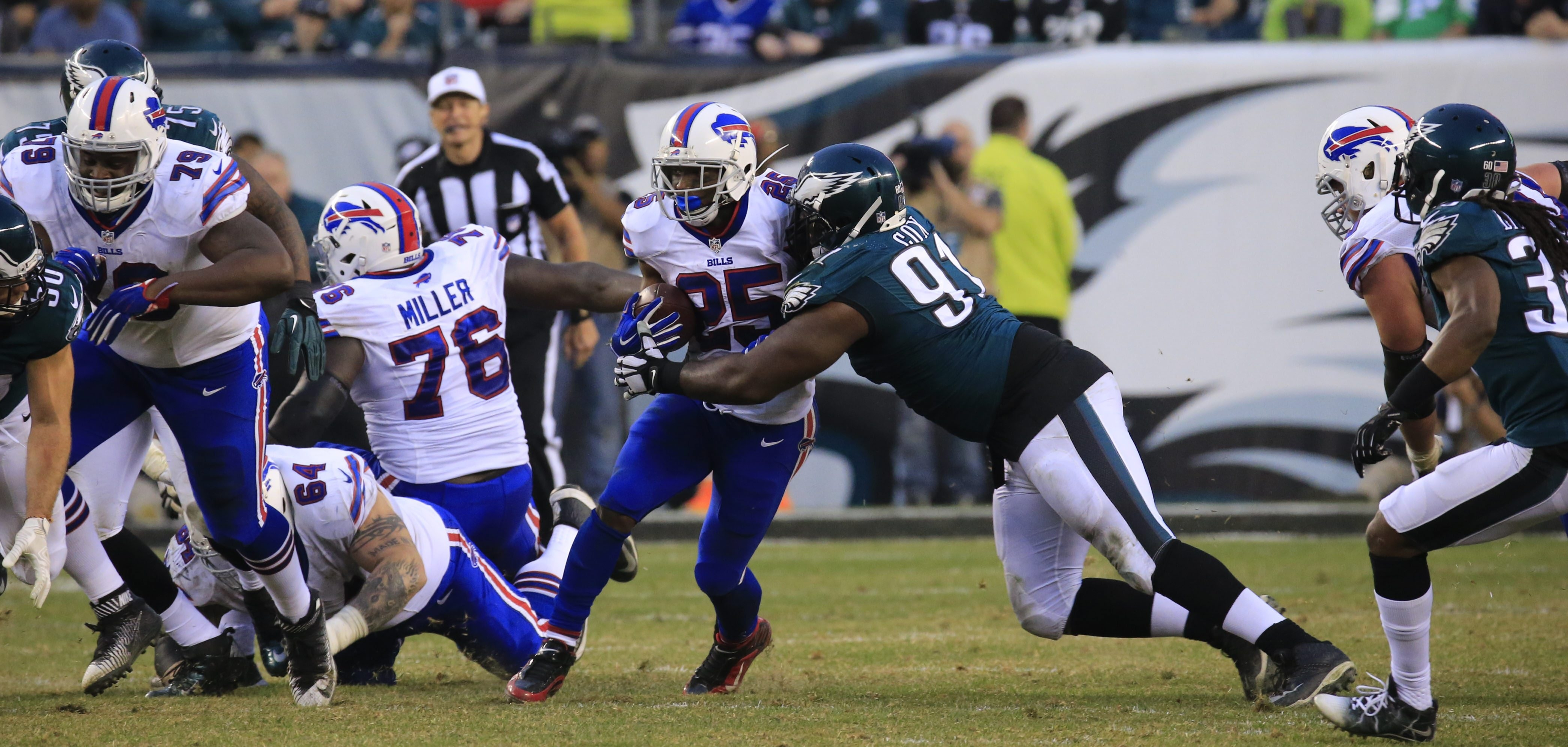 Bills running back LeSean McCoy is wrapped up by Philadelphia Eagles lineman Fletcher Cox during Sunday's game.