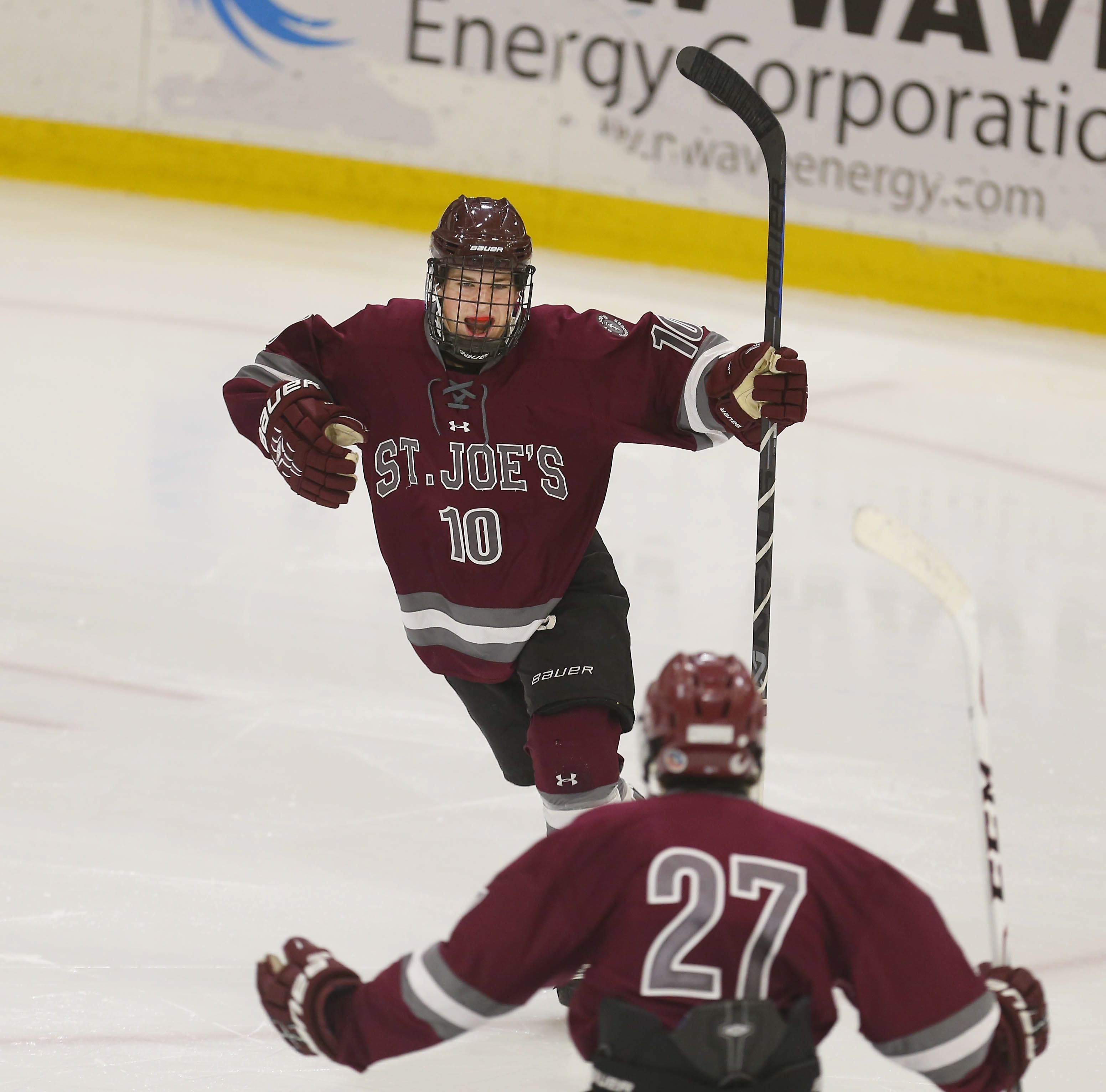St. Joe's Michael Greco (10) celebrates his team's fourth goal of the game with Nicholas Wahler (27) Monday at HarborCenter.