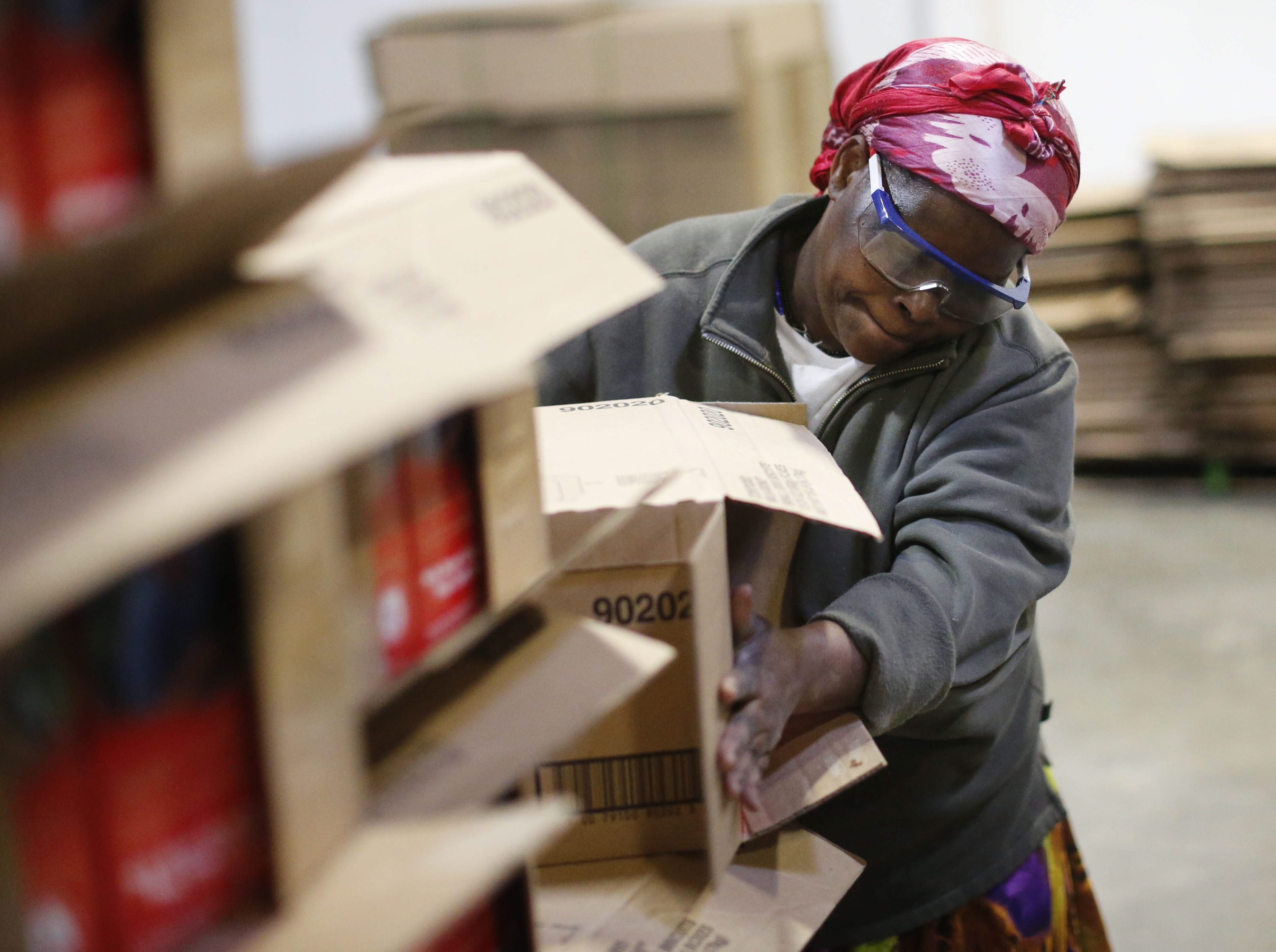 Biljana Bilkeyr, a worker from Diversified Labor Solutions, a program run by the Cantalician Center works on a packing operation at Sonwil Distribution in Cheektowaga, Monday, Nov. 23, 2015.  (Derek Gee/Buffalo News)