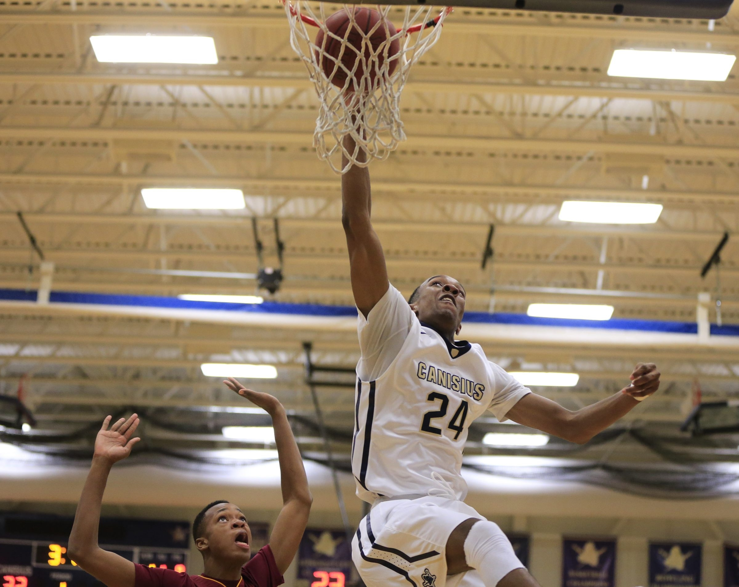 Stafford Trueheart dunks for two of his game-high 23 points as Canisius defeated Nazareth in the Tom Keenan Classic.
