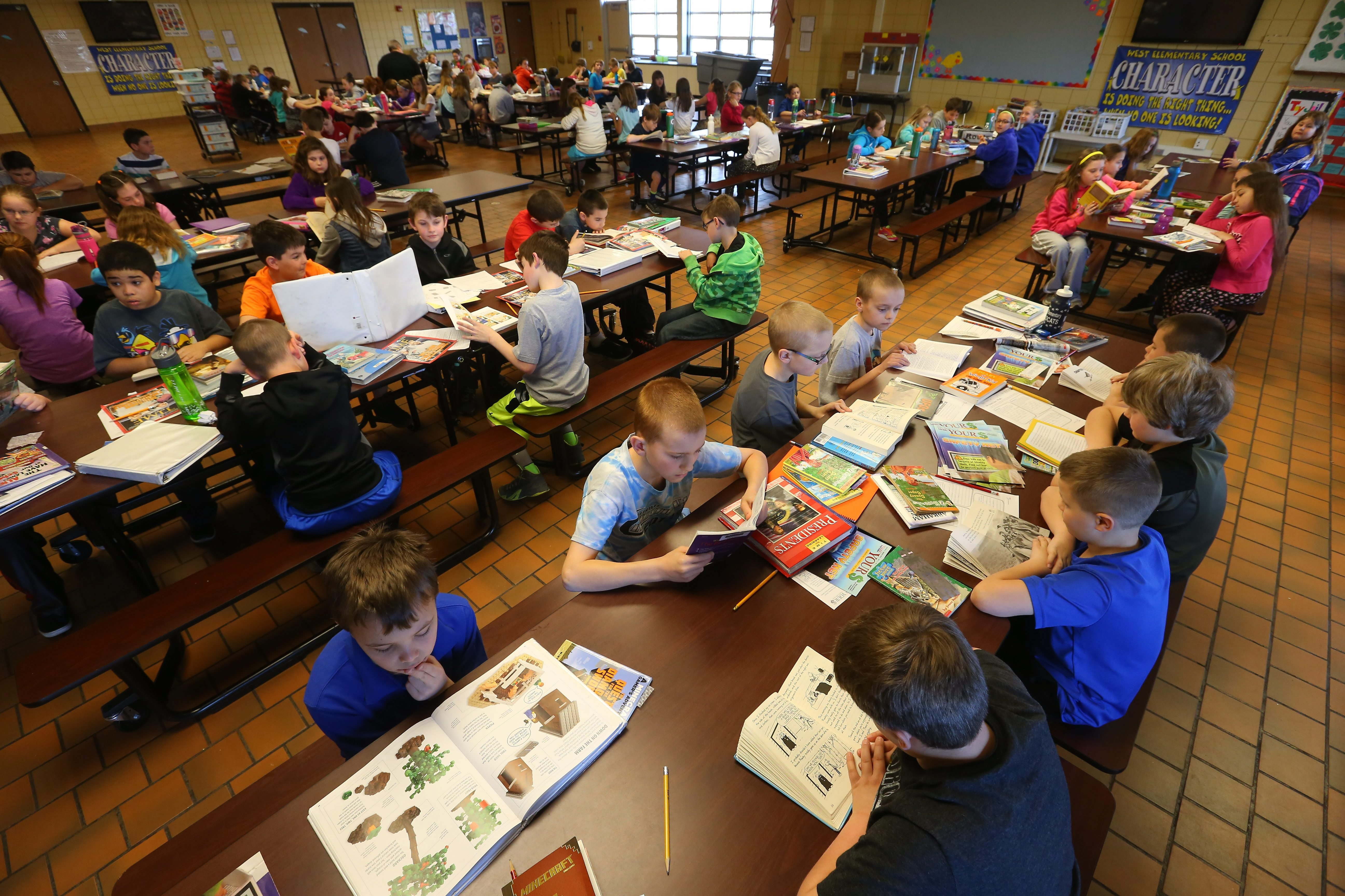 It is not yet clear what impact action at the state and federal level will have on standardized tests given to students. Here pupils opting out of state testing fill the cafeteria at West Elementary in West Seneca in April.  (Mark Mulville/Buffalo News file photo)
