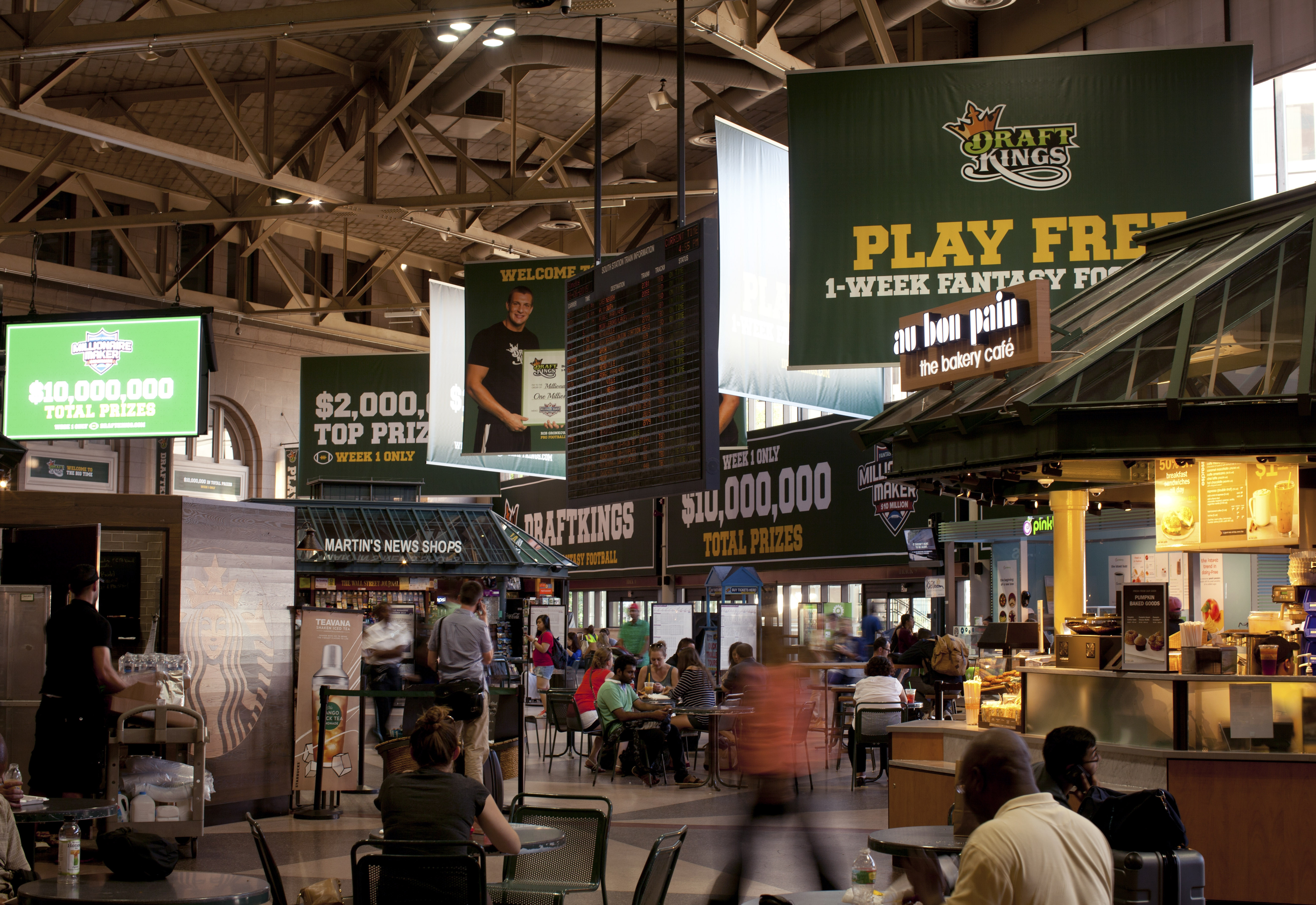 DraftKings, a leading daily fantasy sports site based in Boston, will keep doing business in New York while the legal process proceeds.